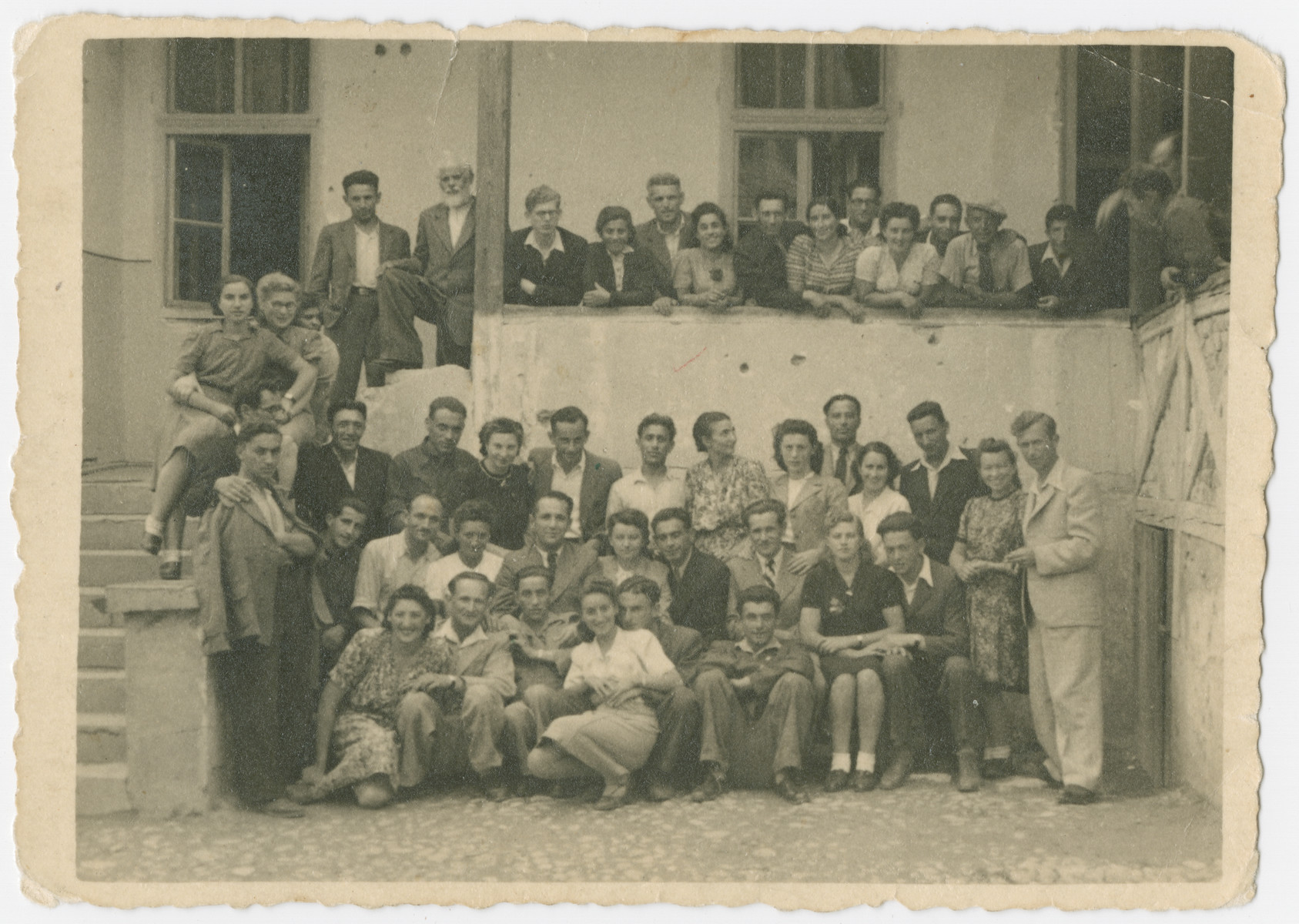 A group of Jewish displaced persons gathers in Italy prior to their immigration to Palestine.  Yehuda Bielski is pictured seated in the second row, third from the right.  Lola Bielski is standing behind him.