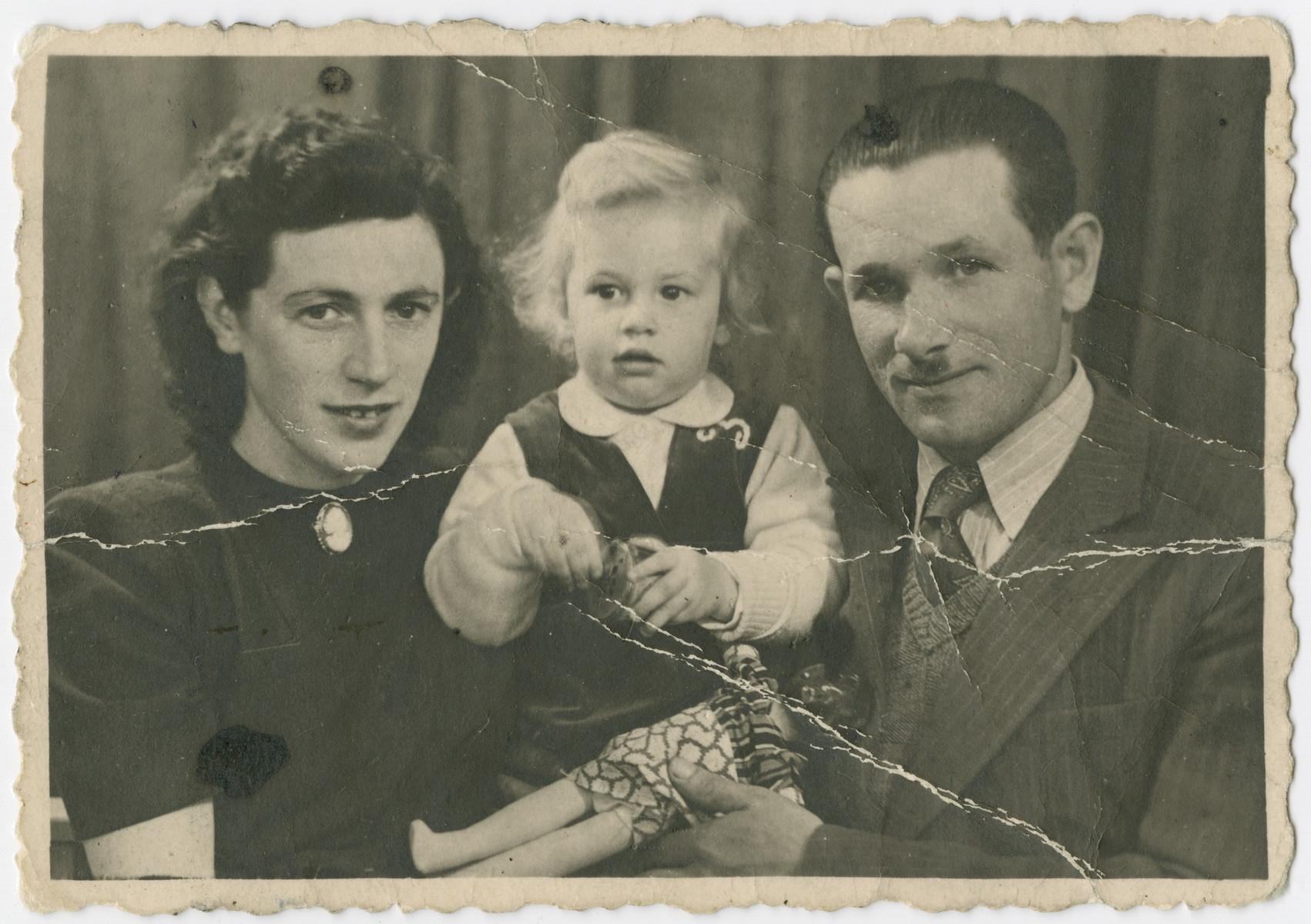 Studio portrait of Lola, Nili and Yehuda Bielski.
