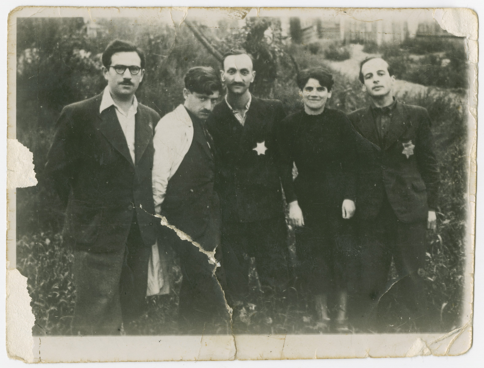 Group portrait of the leaders of the Anti-Fascist partisan group in the Kovno ghetto.  From left to right are Pesach Shachter, Moshe Sherman, Chaim Yellin, Masha Lan and Dima Gelperin.
