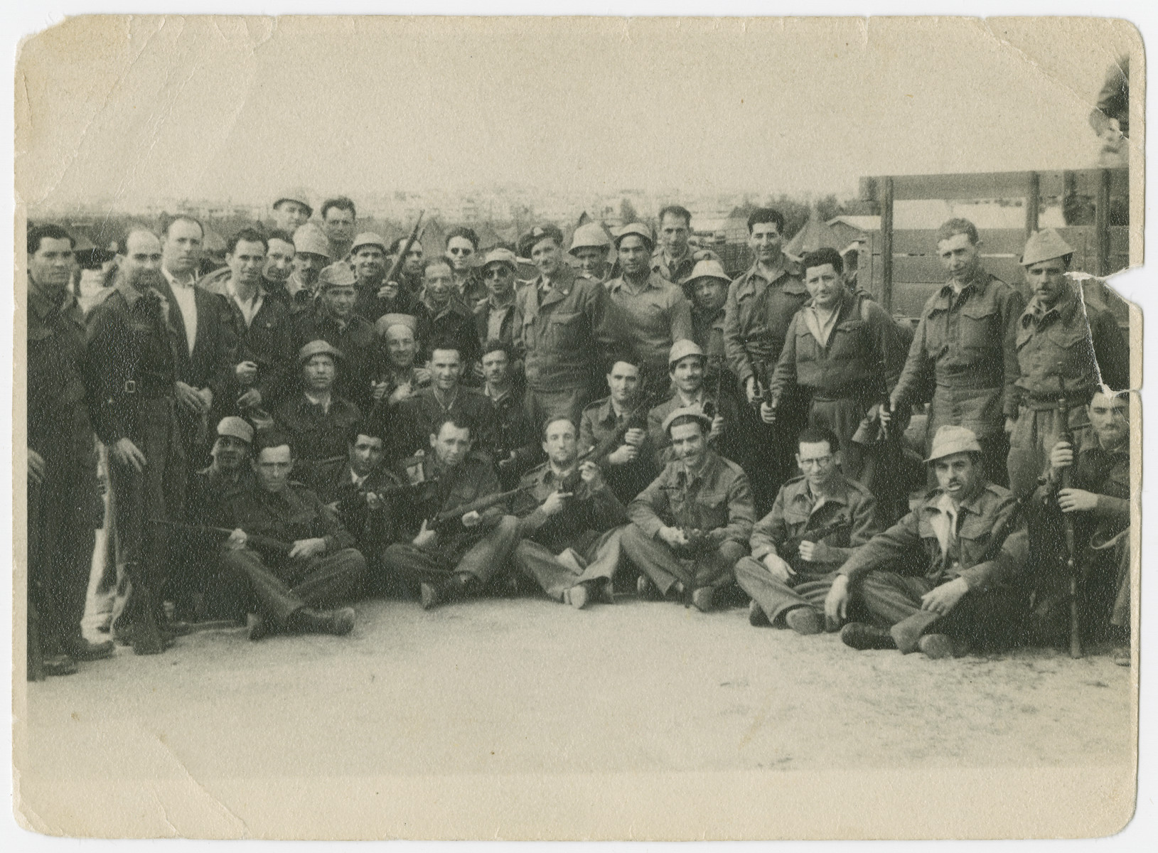 Group portrait of a unit of the Israeli Defence Forces.  Lt. Yehuda Bielski is standing in the center wearing a beret.