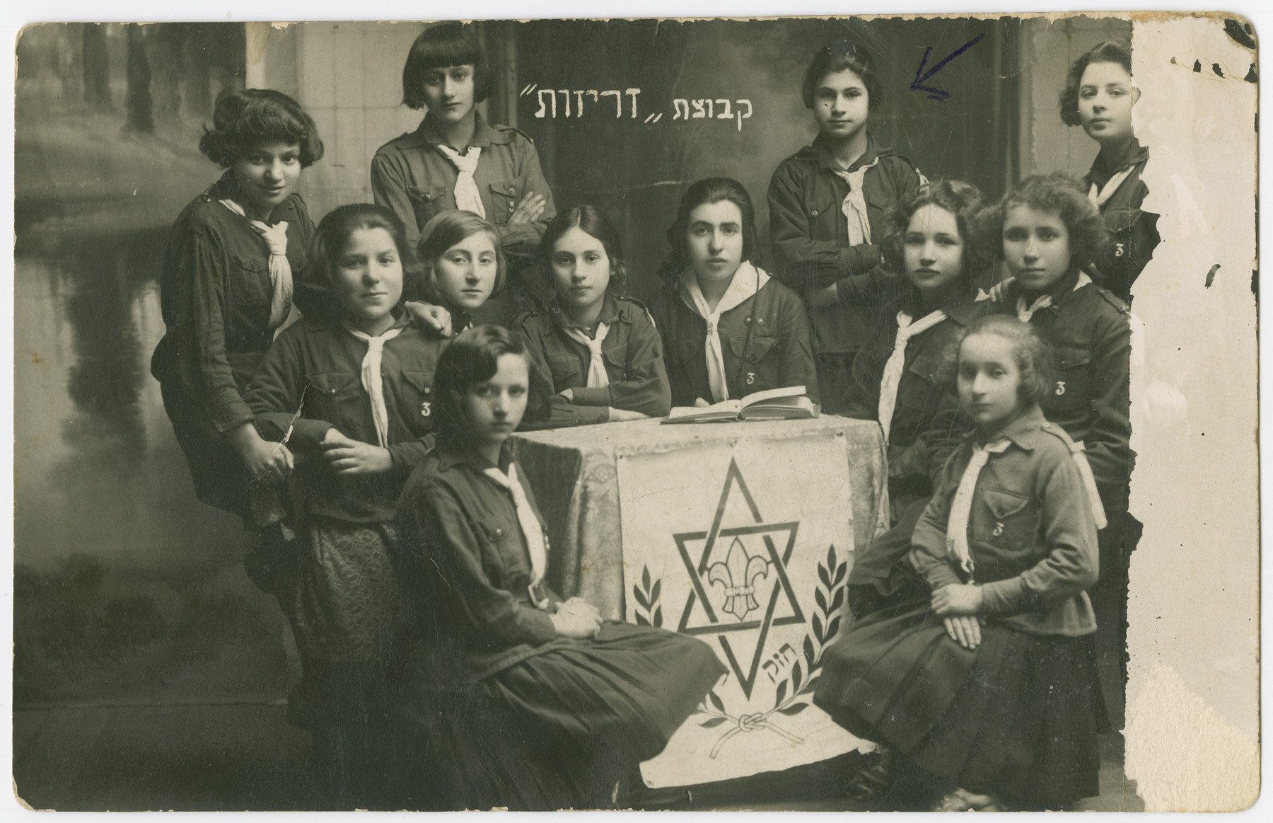 Group portrait of teenage girls in a Shomer Hatzair group in Jurbarkas, Lithuania.  Pictured standing  second from the right is the aunt of the donor, Chana Magidowitz.  Chana and her sister Gitel both perished in the Great Aktion in Kovno on October 28, 1941.