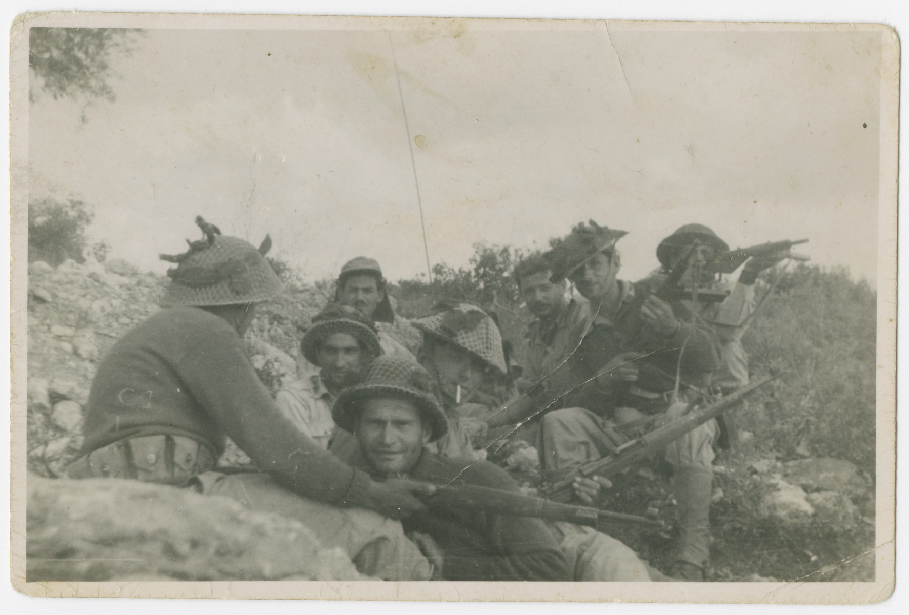 Lt. Yehuda Bielski (right, sitting on a rock) leads a unit of Israeli soldiers during the War of Independence.