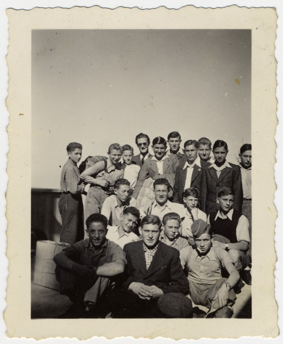 """Group portrait of """"Buchenwald Boys"""", teenage survivors of Buchenwald, in a children's home in Switzerland.  Henry Kolber is pictured in the second row on the far right.  Murray (Monek) Goldfinger is pictured in the first row, on the far left."""