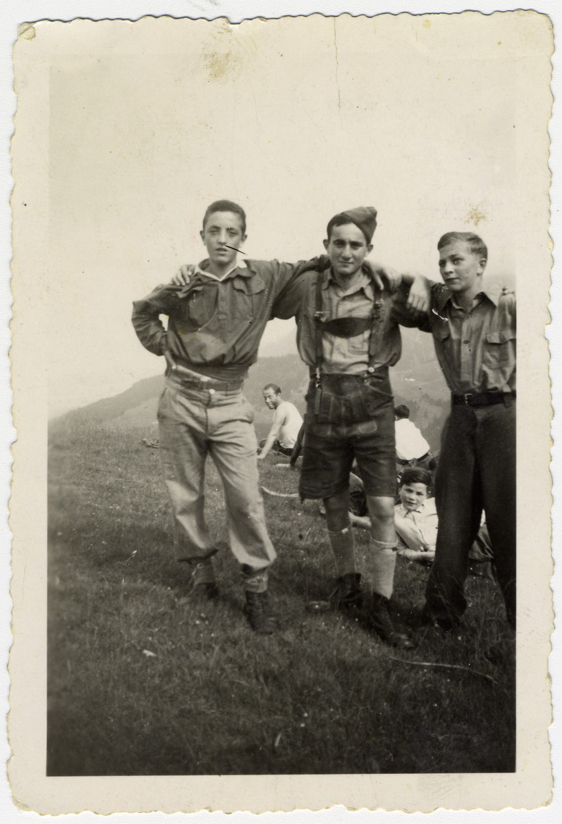 "Group portrait of three ""Buchenwald Boys"", teenage survivors of Buchenwald, in a children's home in Switzerland.  Pictured left to right are Murray Goldfinger, Stanley Appel and Henry Kolber."