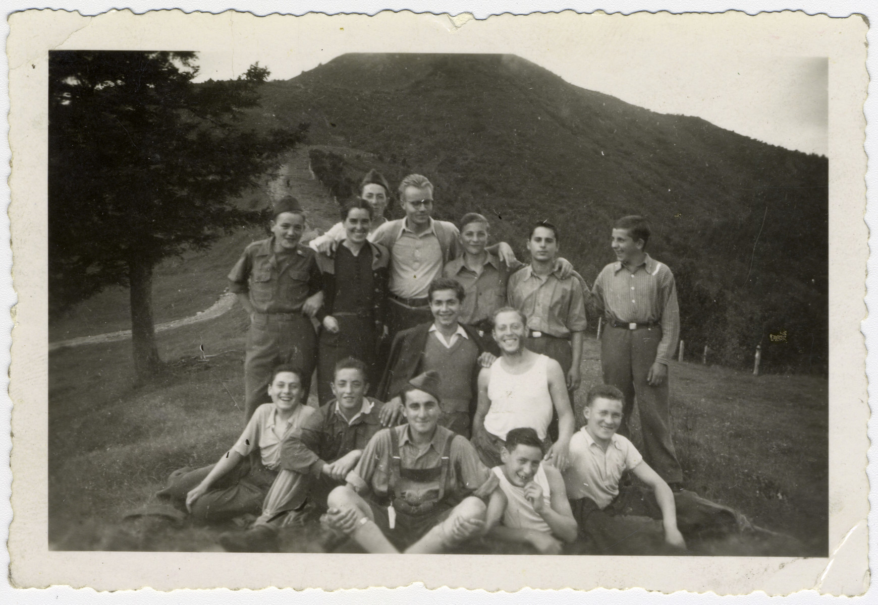 "Group portrait of ""Buchenwald Boys"", teenage survivors of Buchenwald, in a children's home in Switzerland.  Henry Kolber is standing in the center (third from the right).  Seated are Murray Goldfinger (second from the left) and Stanley Appel (center,wearing a hat and lederhosen)."