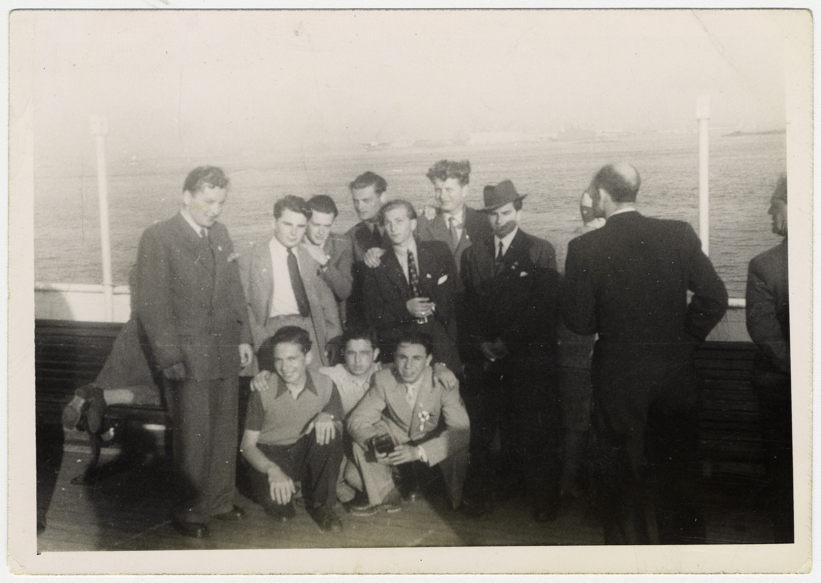 A group of young men pose on board a ship [probably while en route to the United States.  Among them is Henry Kolber.