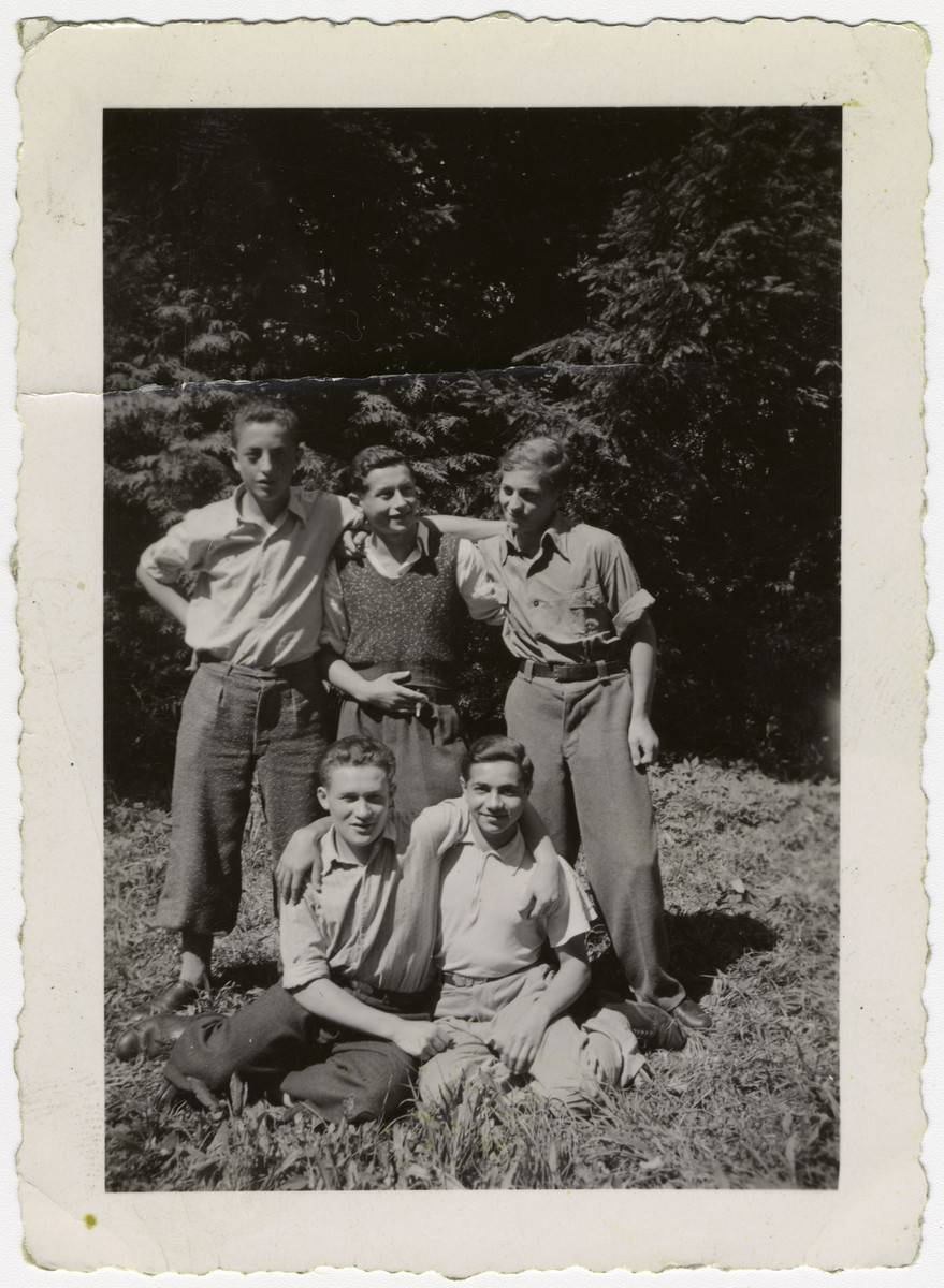 """Group portrait of """"Buchenwald Boys"""", teenage survivors of Buchenwald, in a children's home in Switzerland.  Henry Kolber is pictured standing on the right.  Monek Goldfinger is standing on the far left."""