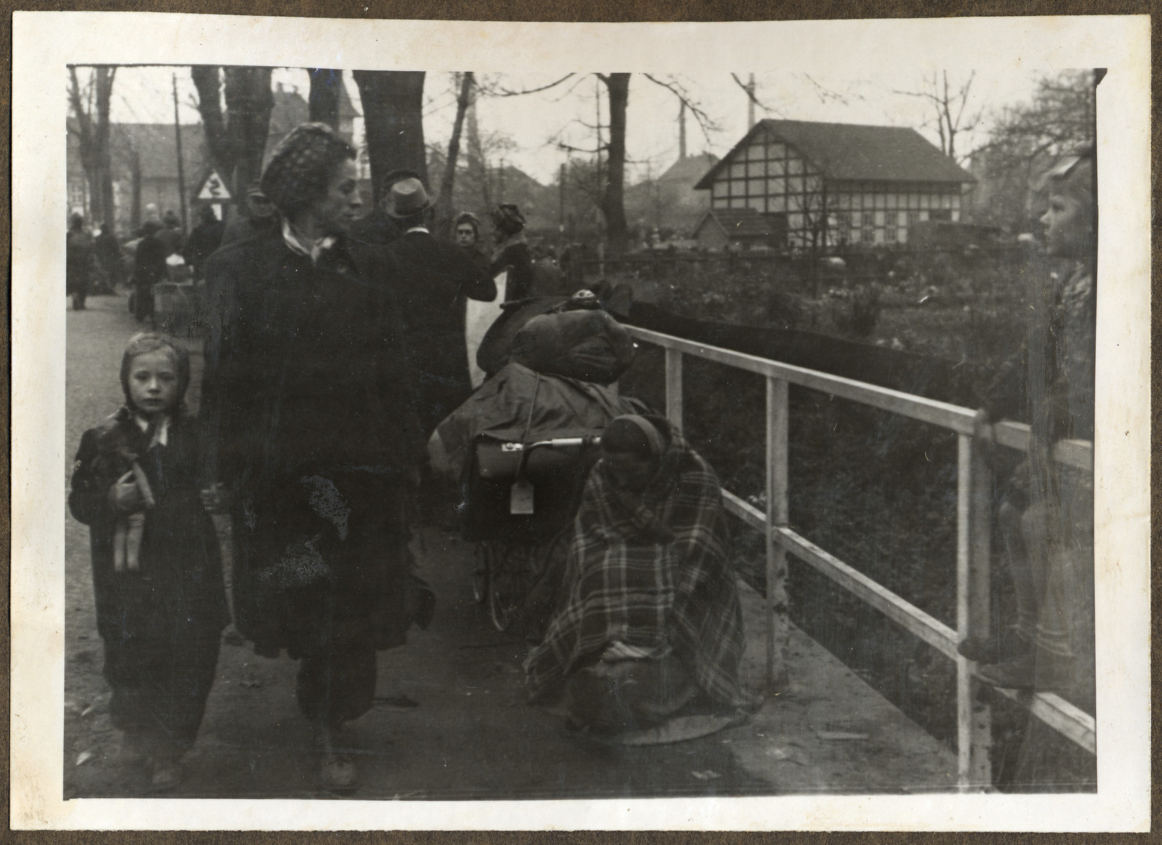 Ethnic German women cross the Elbe River into Germany after their expulsion from Eastern Europe.