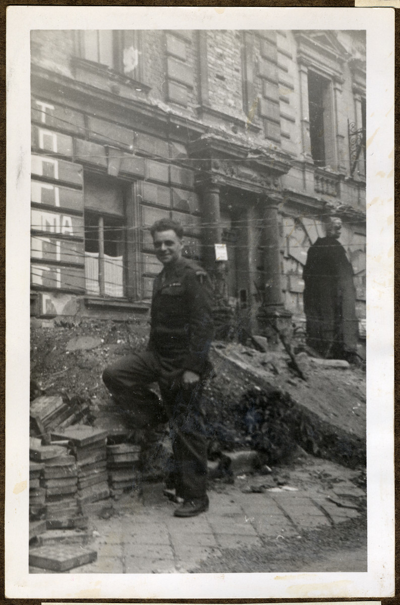 Joseph Eaton, an American soldier and Jewish German emigre poses in front of the rubble at Fuertherstrasse 6 in his hometown of Nuremberg.