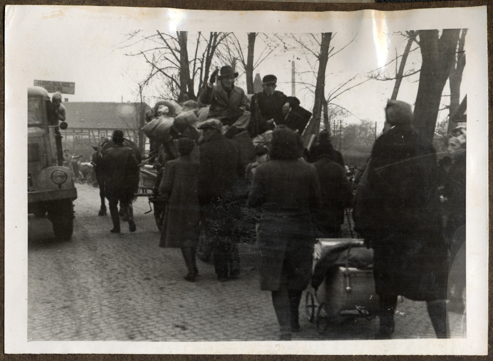 Thousands of Germans enter and leave from the British to the Russian Zone of Occupation on the road to the Friedland Refugee Camp.