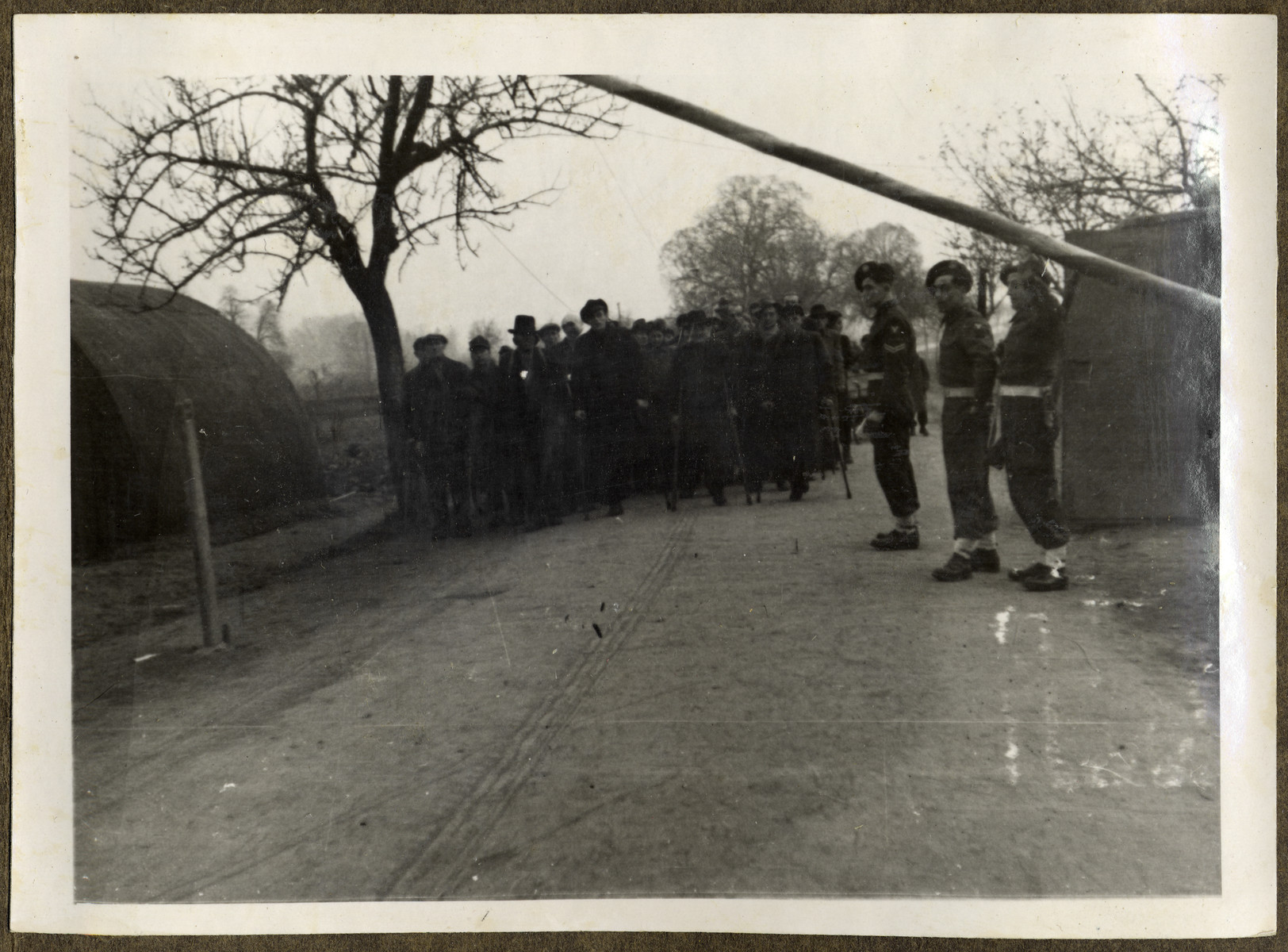 British soldiers guard the entrance to an unidentified displaced persons' camp.