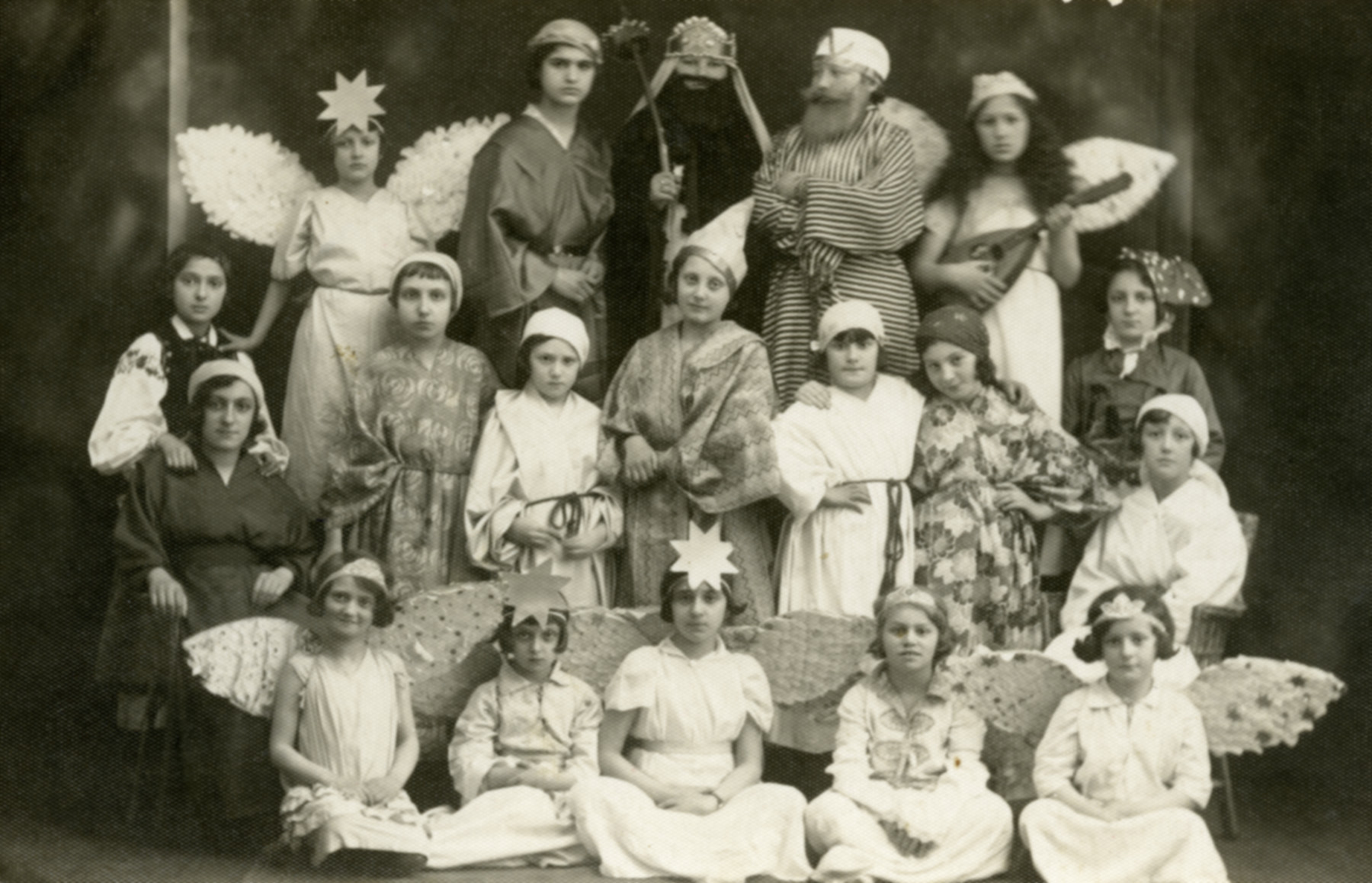 "Beis Yaakov students perform in a play called ""Joseph and His Brothers."" Esther Wagner can be seen in the second row, fifth from the right."