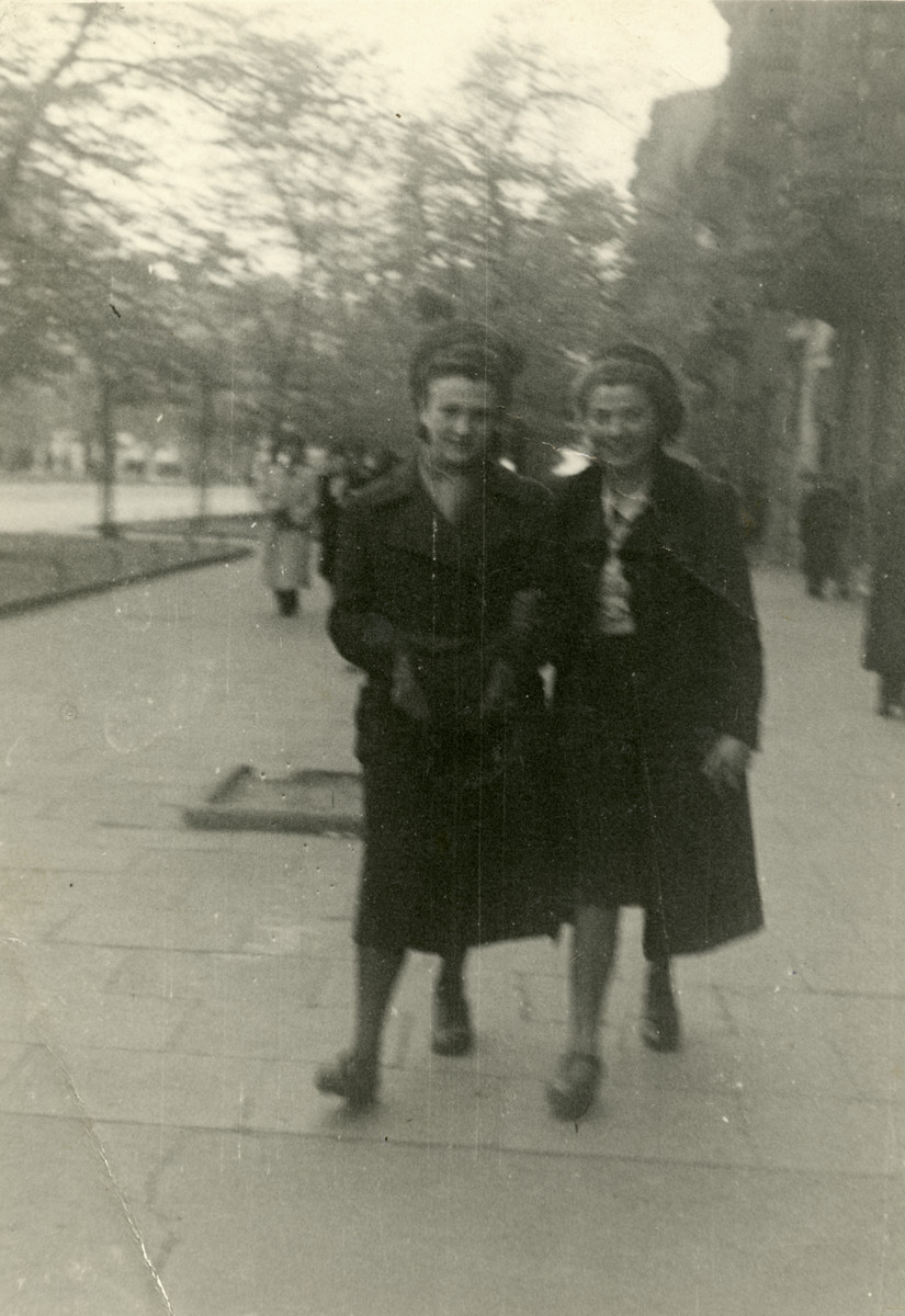 Two Jewish girls in hiding walk down a street in Warsaw.  Pictured on the left is Esther Willig who was living under the name Paulina Wilanska.