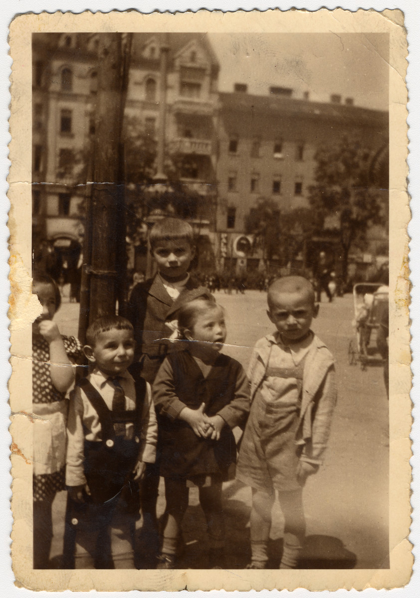 Hungarian Jewish children gather on a street in Budapest.  Ervin Biel is on far right,.