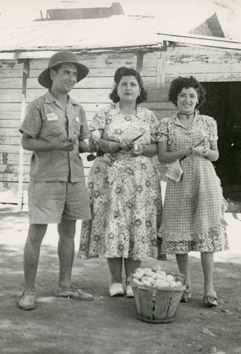 Shimon Sousson and two women peel potatoes in Mahane David, an immigration camp for North African Jews en route to Israel.