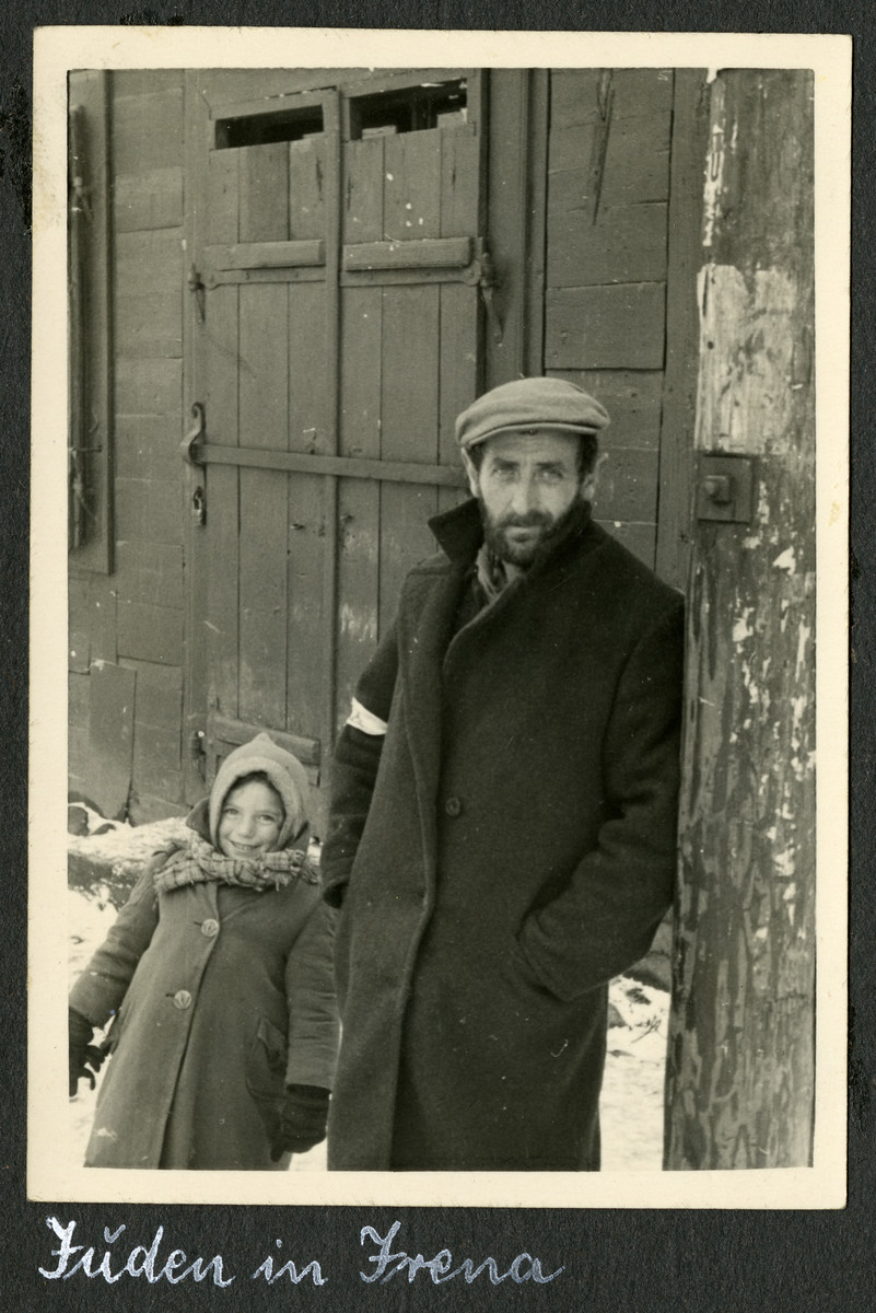 "Close-up portrait of a bearded man and young child in the Deblin-Irena ghetto.  The original caption reads: ""Jews in Irena."""