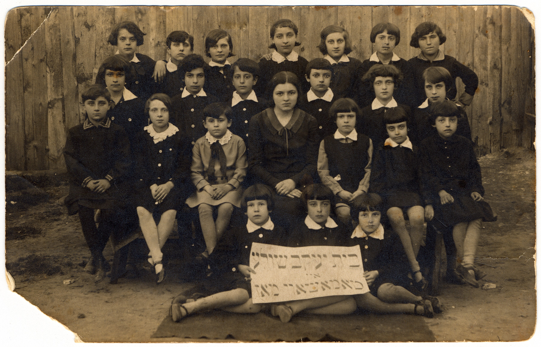 Class portrait of a Beit Yaakov, religious girls school in Tomaszow Mazowiecki.  Roza Grynspan is pictured in the top row, second from the right.
