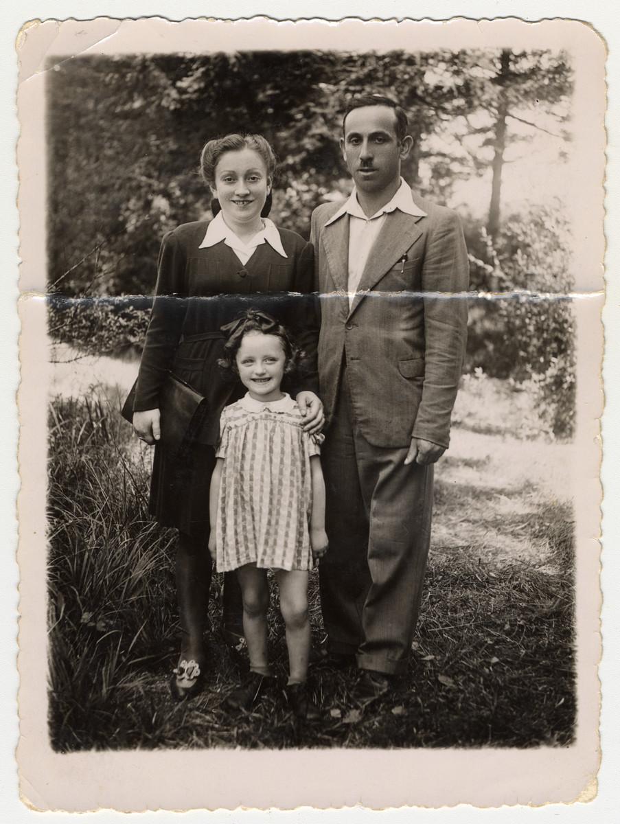 Portrait of Regina Fenster (later Gertner), her daughter Lusia Fenster (later Lucy Gertner), and her future husband Samuel Gertner at the Foehrenwald Displaced Persons Camp.