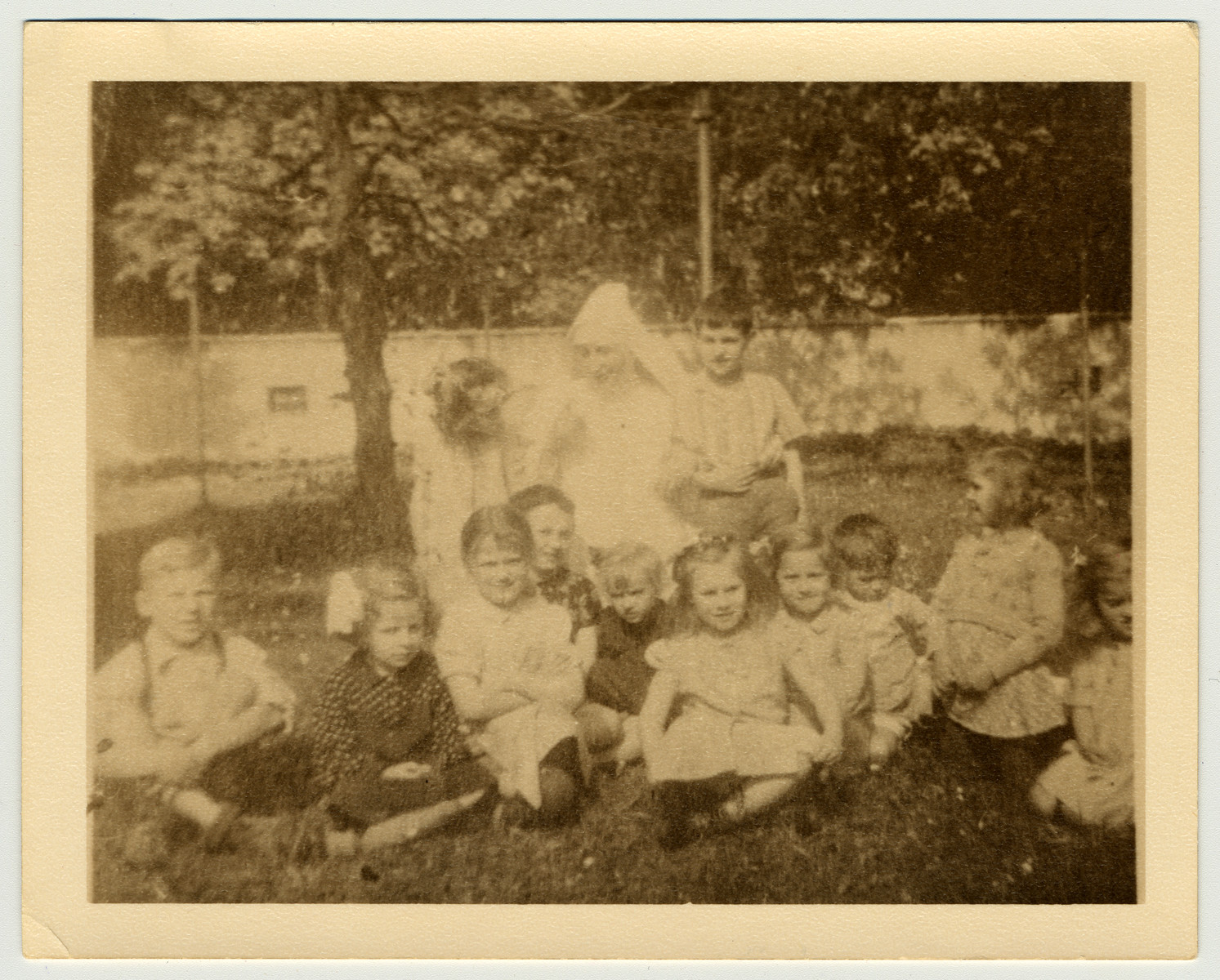 Group portrait of children in hiding in a convent in Czernowogrod.  Among those pictured is Lusia Fenster, back row far left.