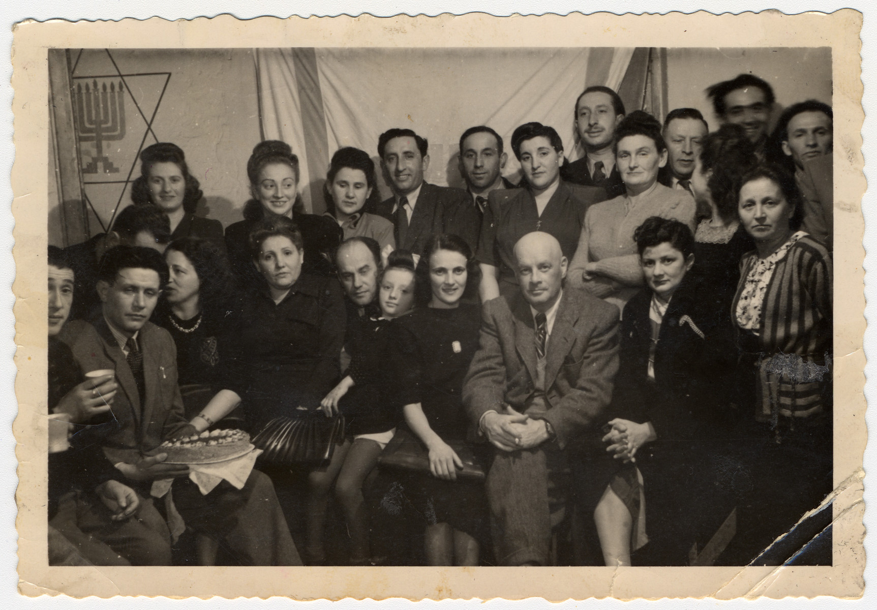 Group photograph of displaced persons in the Foehrenwald Displaced Persons Camp.  Among those pictured are Regina Gertner (back row, second from the left), Samuel Gertner (back row, fifth from the left), and Lucy Gertner (front row, child fifth from the left).