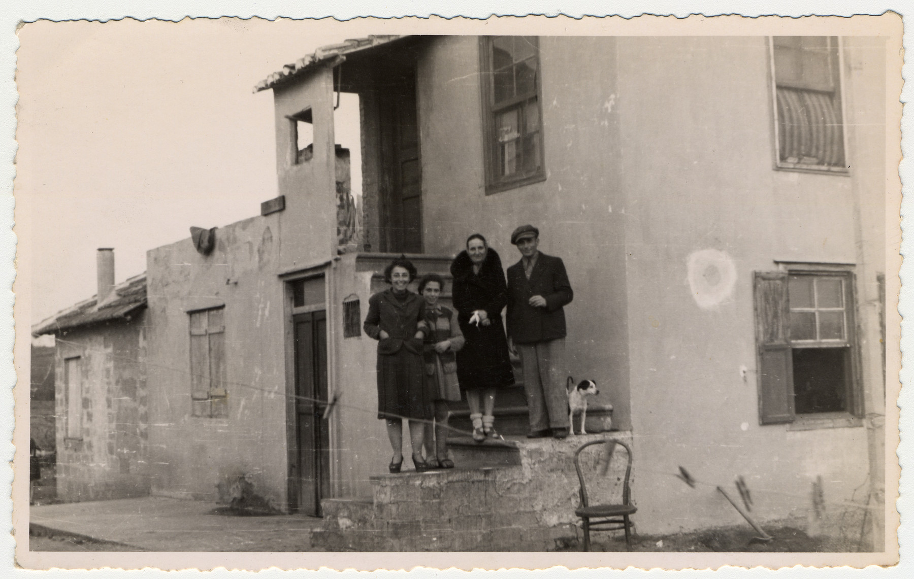 Jewish refugees stand on the steps of their home in Albania.  Pictured from left to right are Alice Gerechter, her daughter Johanna Jutta Gerechter, Lizalotte Pilku and Siegbert Gerechter.  The Gerechter family lived in this house from June 1941 to August 1943.