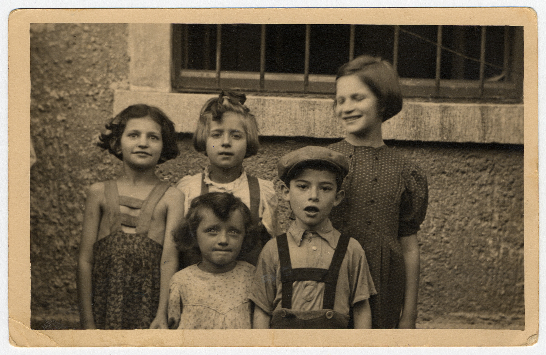 A group of children in the Salzburg Displaced Persons Camp.  Among those pictured are Lusia Fenster (later Lucy Gertner), front row left; Channah Kaplan (later Charlotte Borofsky) on the far left; and Shainka Kaplan (later Janet Wenitsky) on the far right.