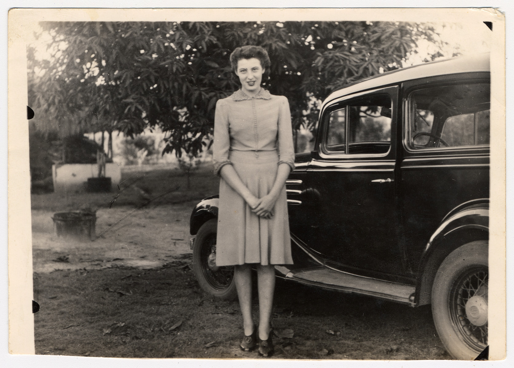 A female German Jewish refugee stands nexts to her automobile in the Congo.  Pictured is Rosemarie Molser.