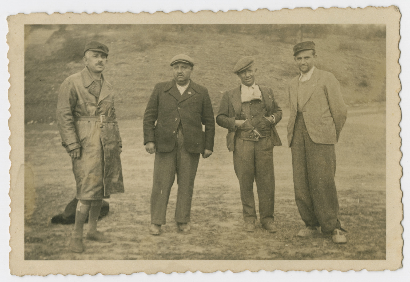 Group portrait of four men in a Bulgarian labor camp.