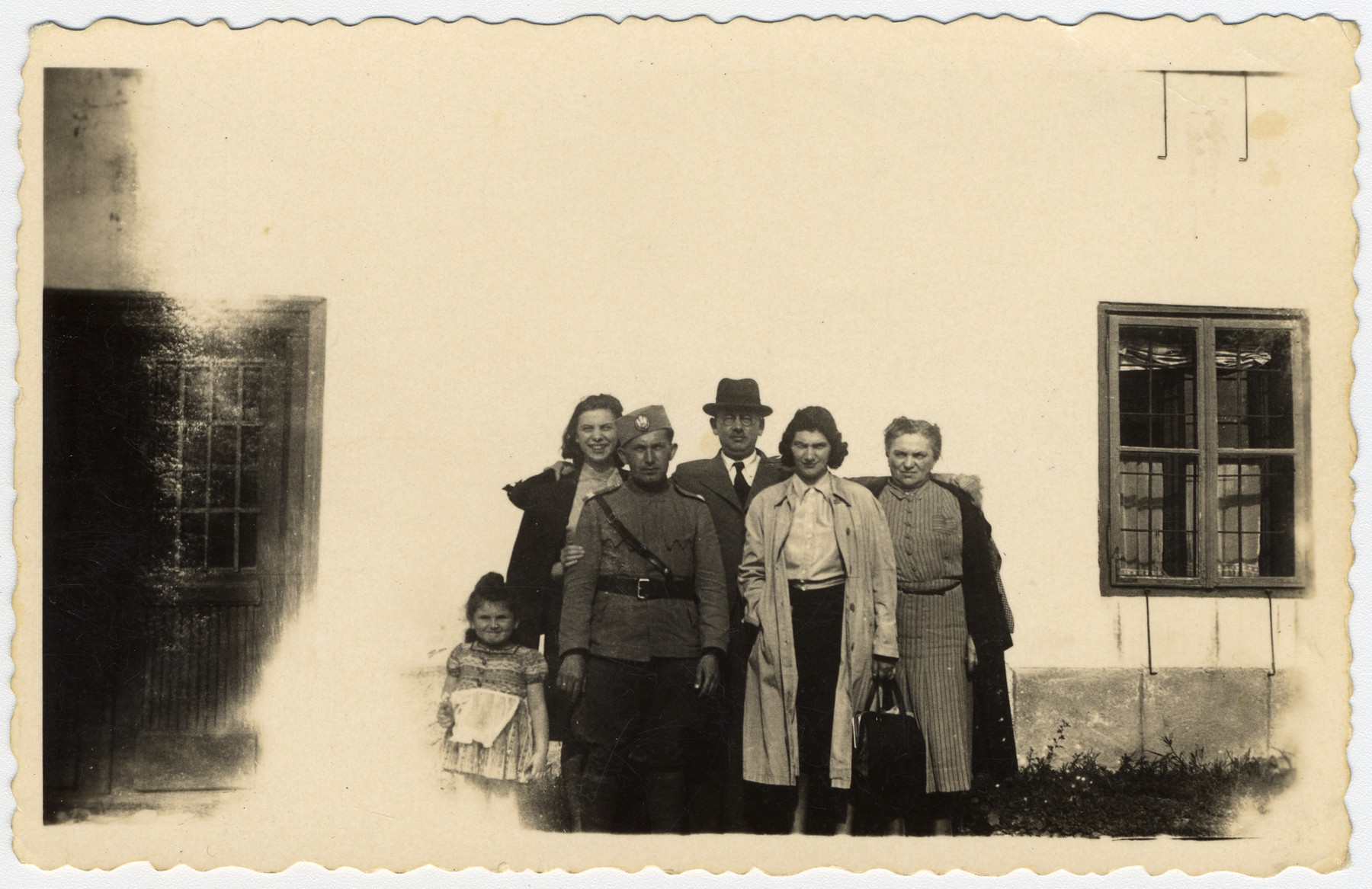 The Willer poses together about a year prior to the invasion of Yugoslavia.  Pictured from left to right are Rina Willer, Claudia Juhn, Andor Willer (wearing army uniform), Benjamin Schlesinger, Marta Willer and Elsa Schlesinger.
