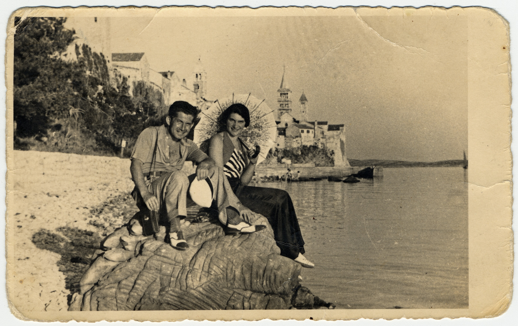Andor and Marta Willer rest on a large rock on the Adriadic coast during their honeymoon.
