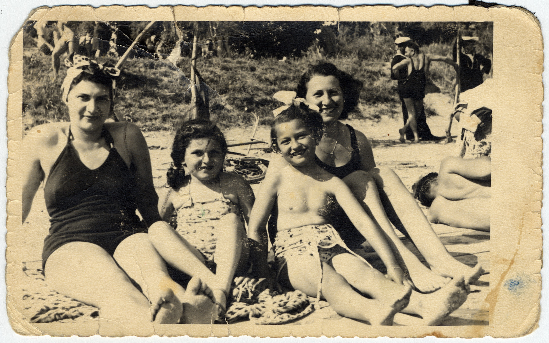 Marta and Rina Willer and another mother and child visit the beach while hiding in Split.  Also pictured is Anita Attias.