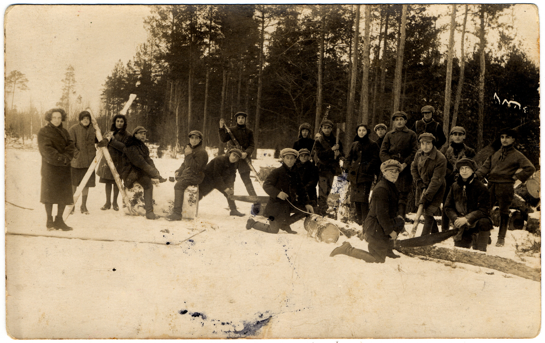 Zionist youth in Kibbutz Tel Chai, a hachshara in Michalin, chop wood in the snow.