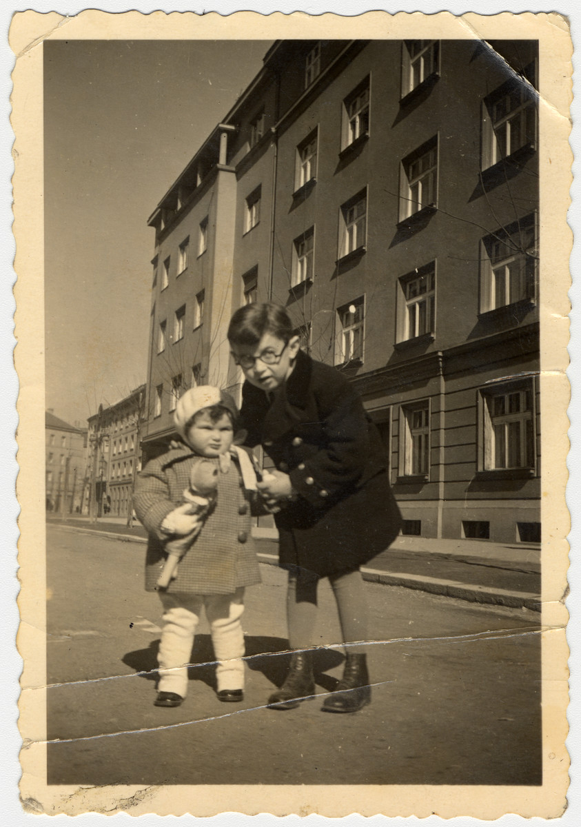 Rina and her cousin Reuven Stein pose on a street in Zagreb.  Reuven was the son of Ella Willer. He perished a few years later in Auschwitz.