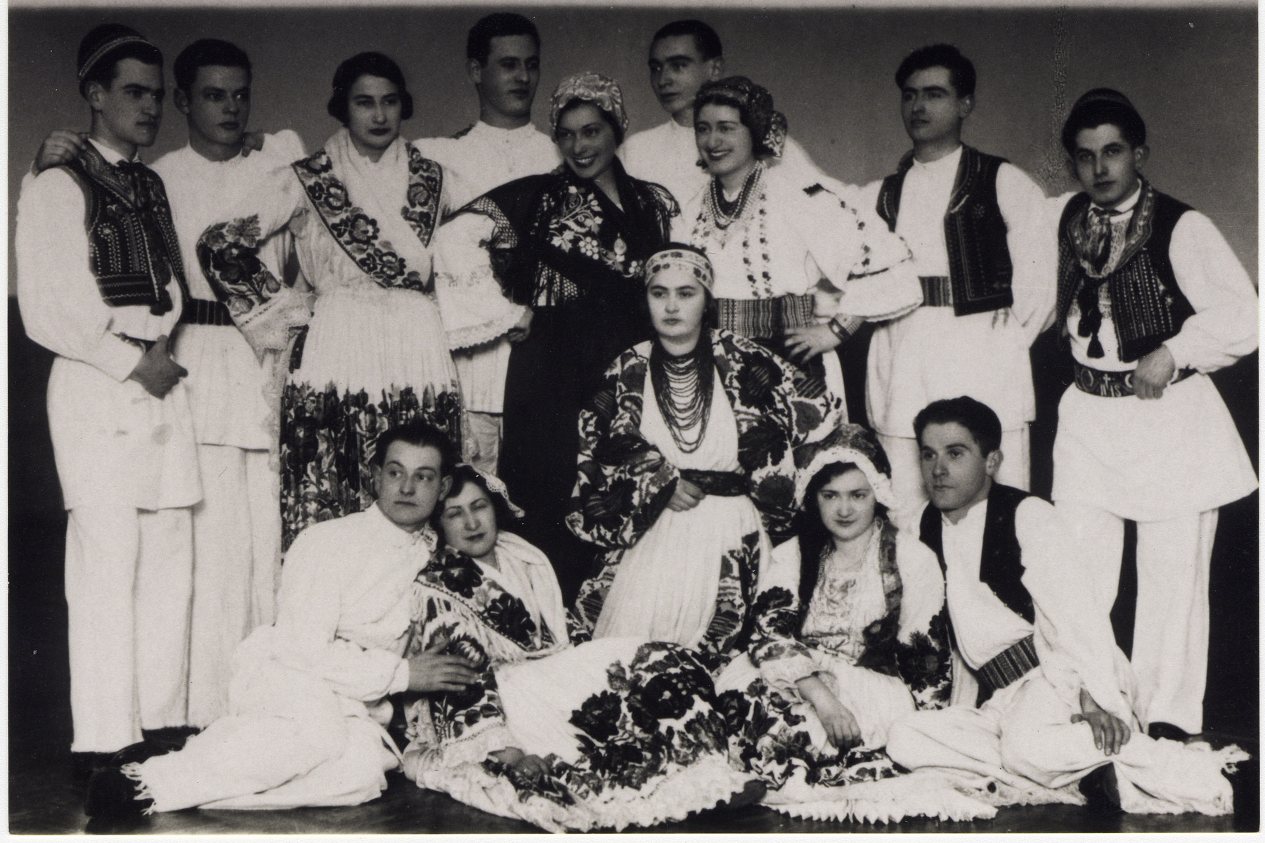 The Yugoslav team at the Maccabi games in Palestine poses in traditional folk costumes.  Andor Willer, a member of the fencing team, stands on the far right.