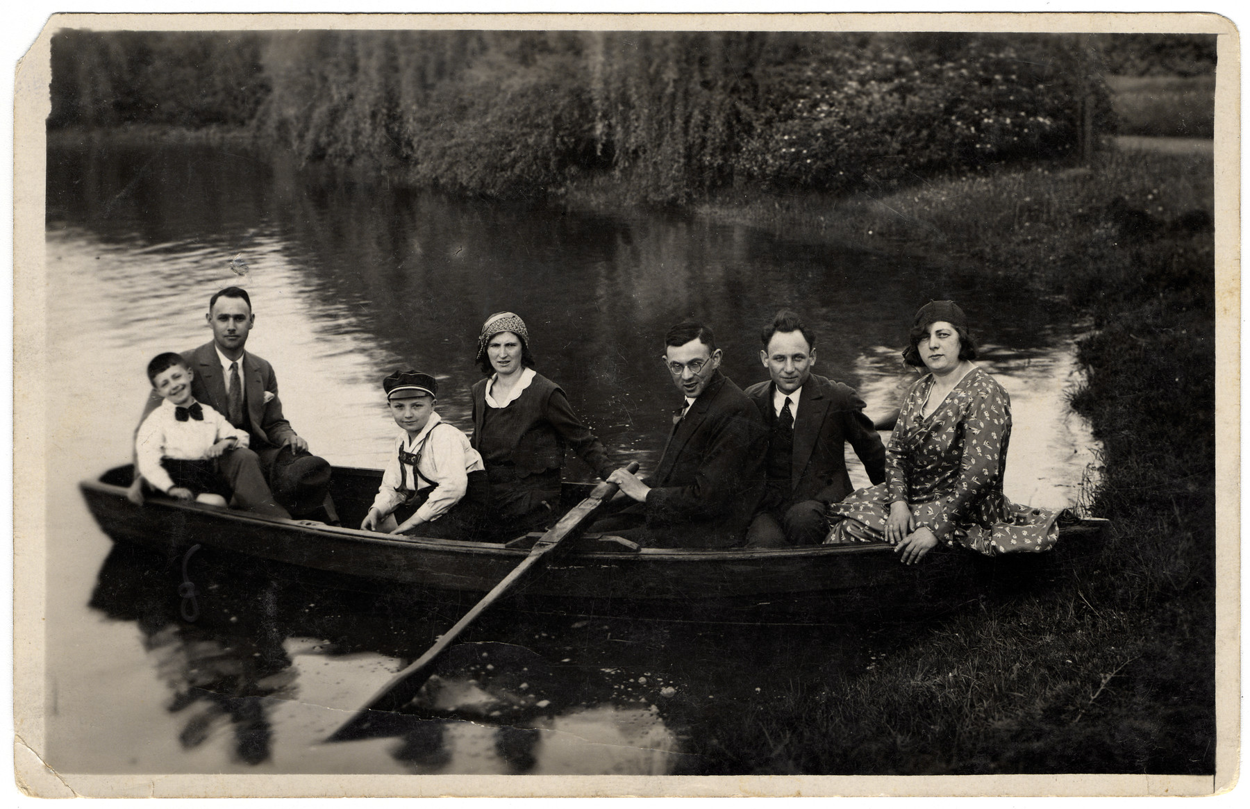 A group of friends goes for a row boat ride.  Herman Bleiweis is rowing.