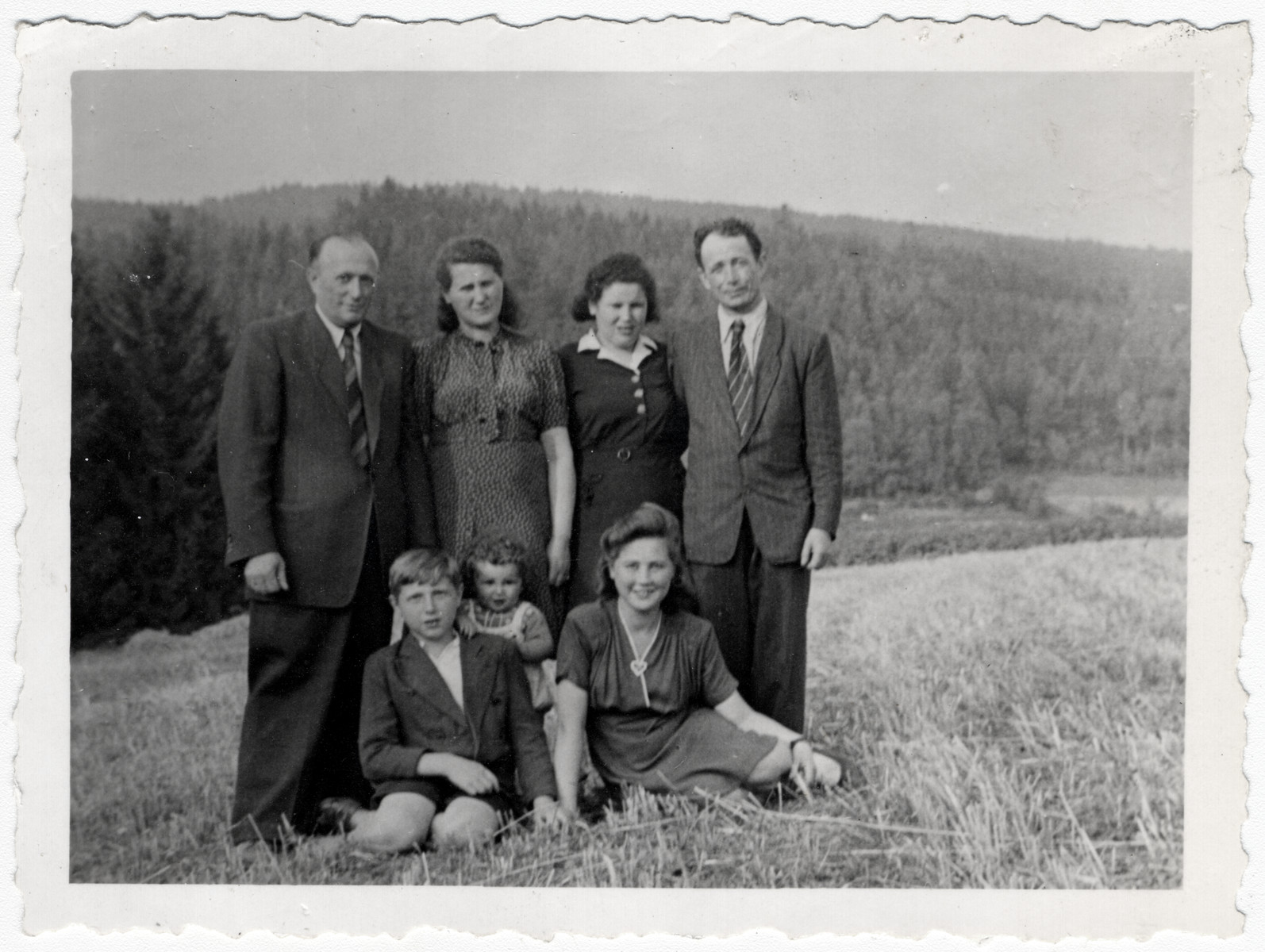 The Malach family poses with their friends and cousins, the Reichmans in Amberg.  Front row: Abraham Malach, Abraham Reichman and Bela Malach.  Standing: Mordka and Chana Malach and Gitl and Mordechai Reichman.