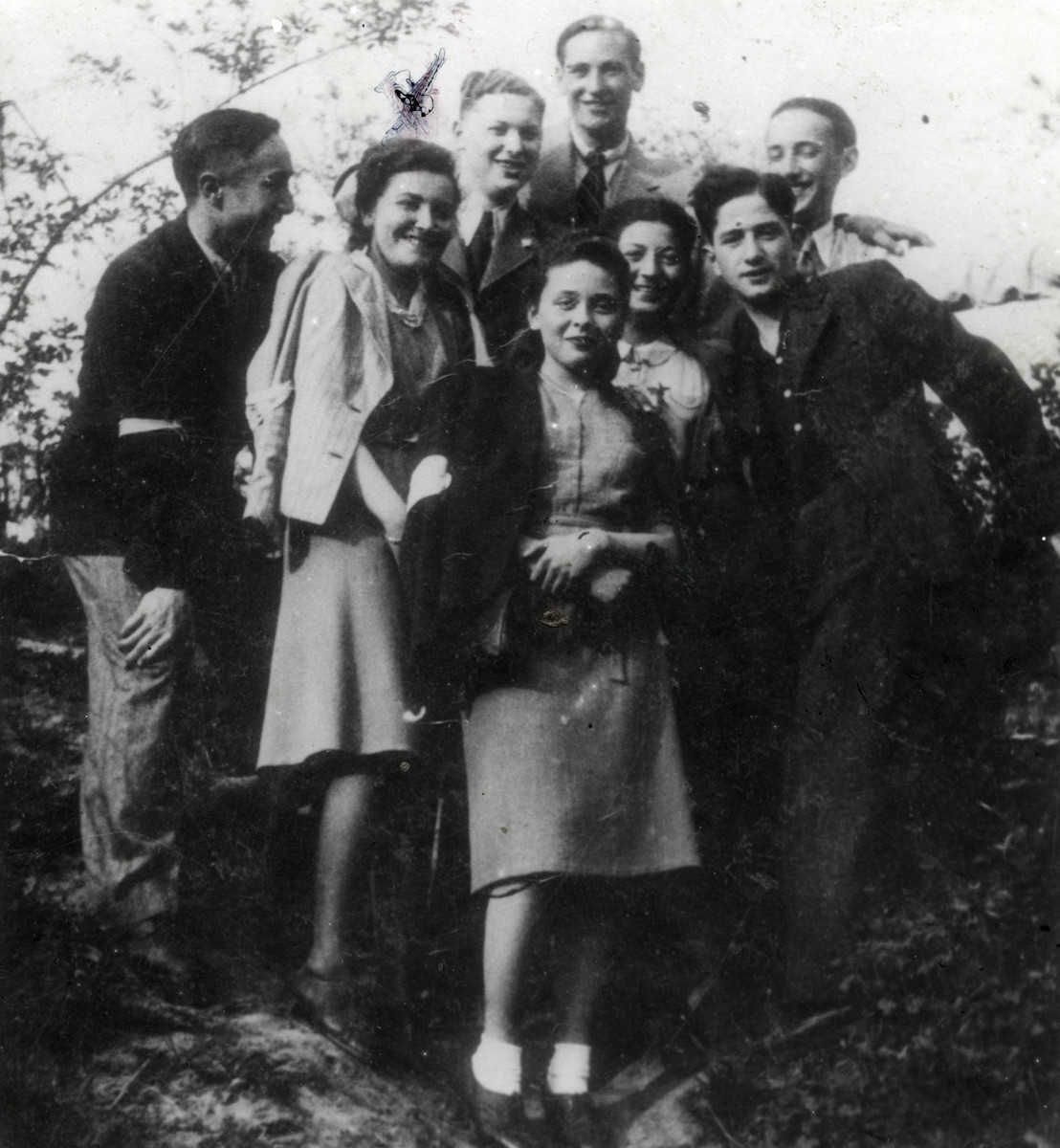 Group portrait of young people from a Zionist group in the Lublin ghetto.  Regina Fryd is pictured second from the left.  This photo was taken one year before she was murdered.  Also pictured are Stella Rubinlicht in front and her husband in the back, center.