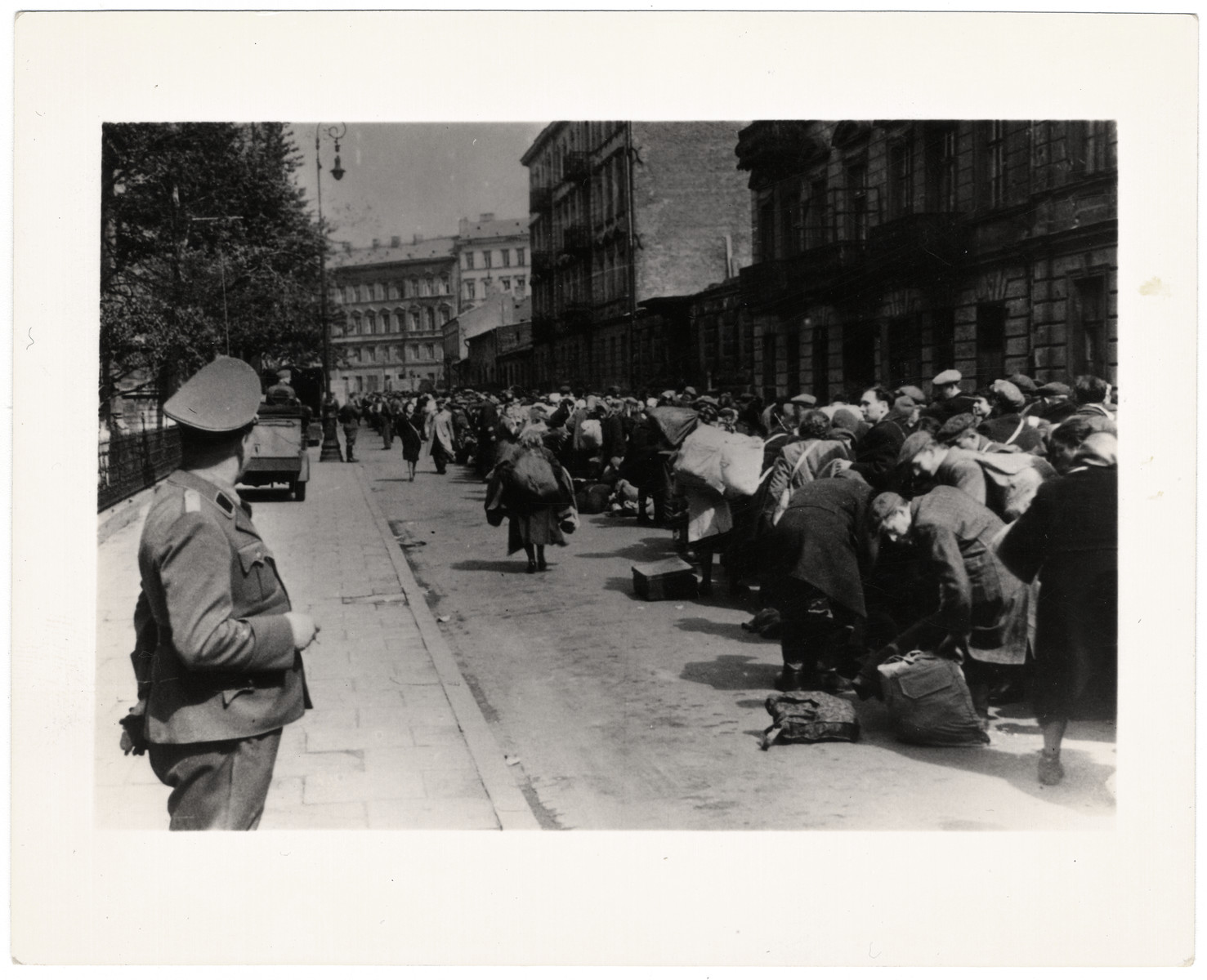 A SS solider oversees the deportation of survivors of the Warsaw ghetto uprising.