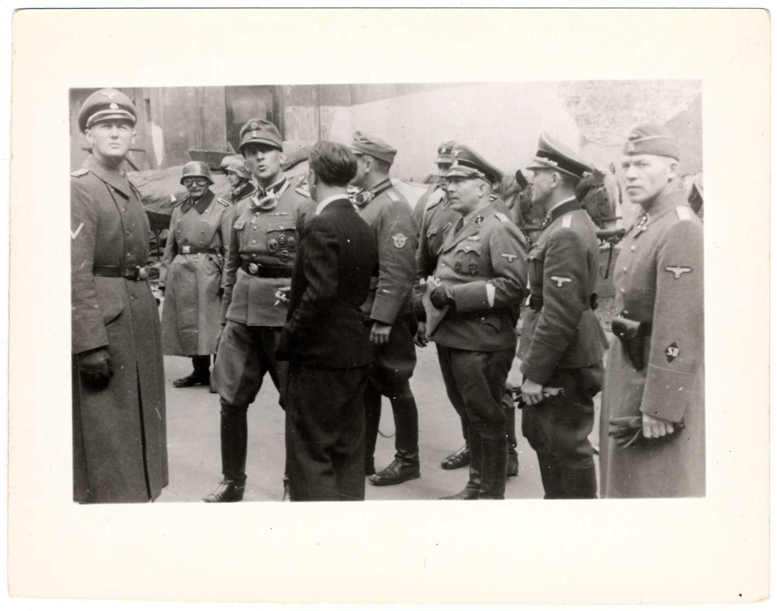 A group of German SS troops speaking to an unidentified man following the supression of the Warsaw uprising.