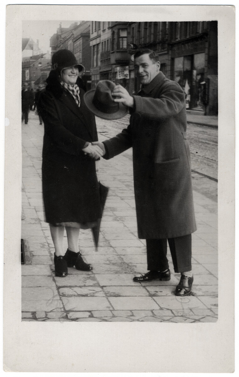 Nesie Bleiweis shakes hands with a friend on a street in Gladbelk, Germany.