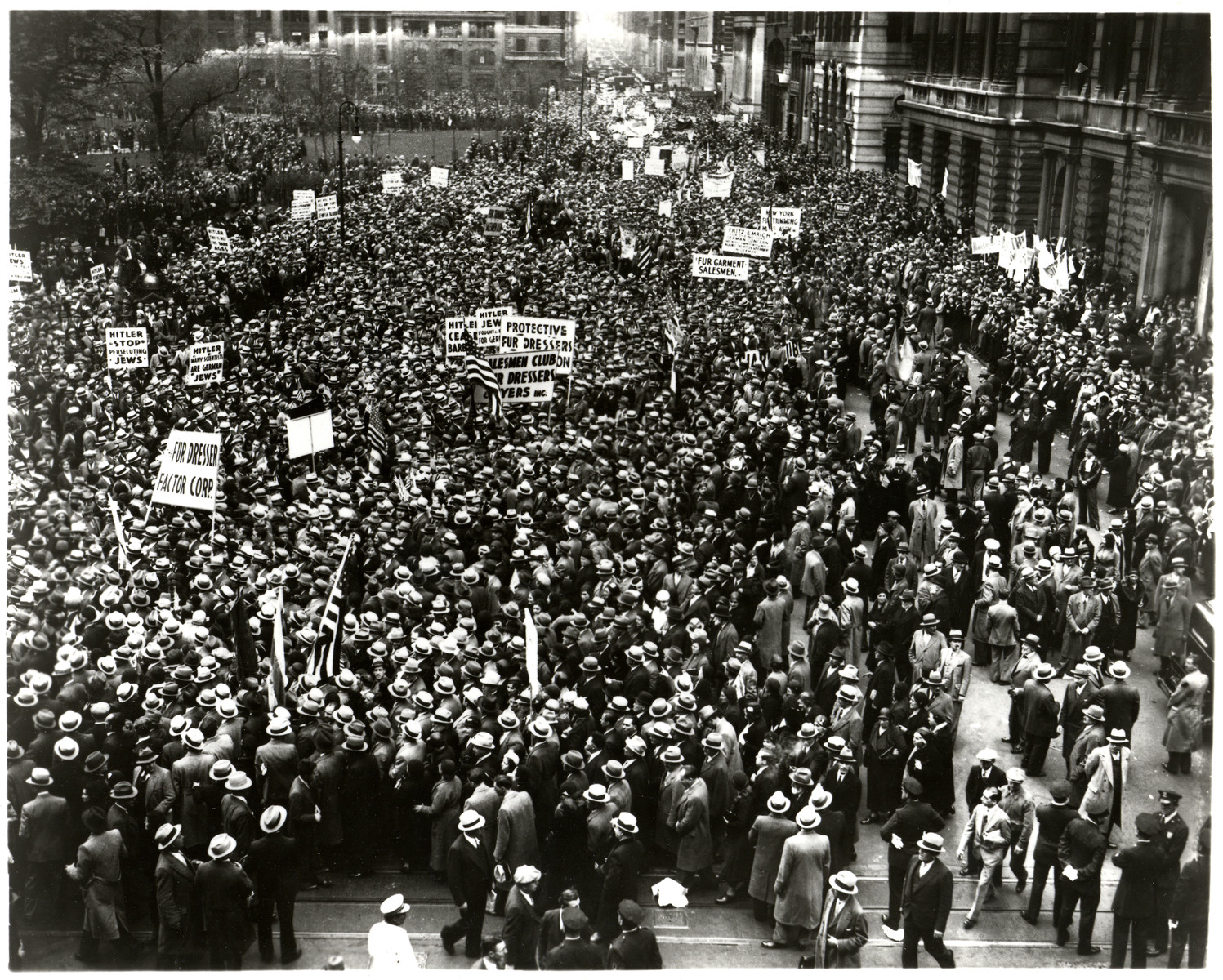 An estimated 100,000 people gather in front of Madison Square Garden in Manhattan to participate in a mass march to the Battery to protest the Nazi persecution of German Jews.