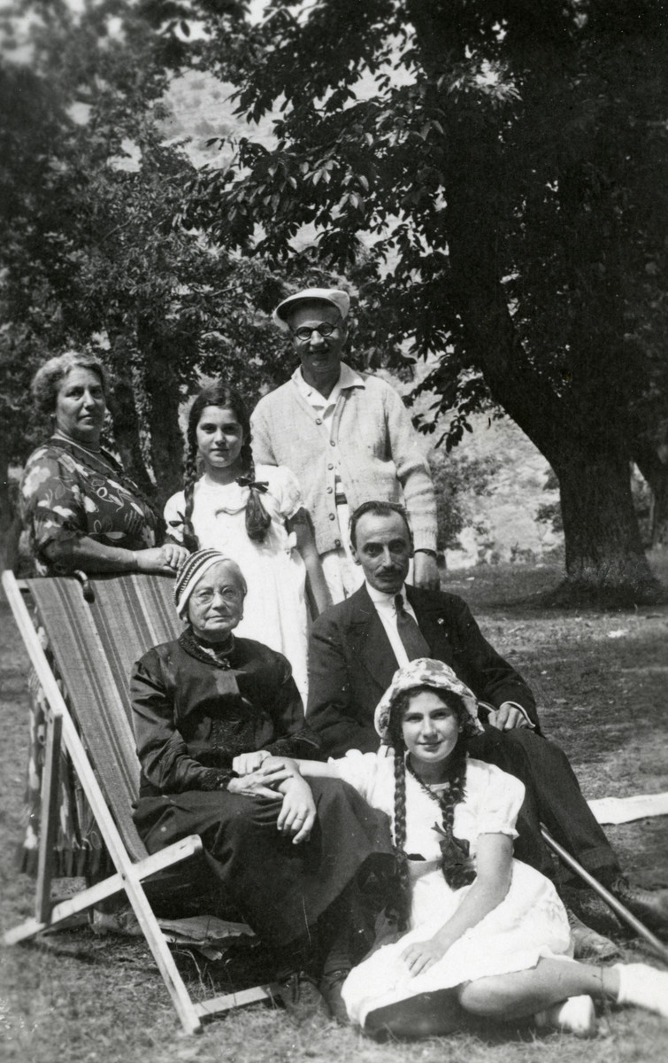 The Morpurgo family gathers outside while on vacation near Genoa.  Pictured sitting are Renate Montefiore (donor's grandmother), Lianna Morpurgo, unidentified. Standing are Margherita, Alda and Umberto Morpurgo.