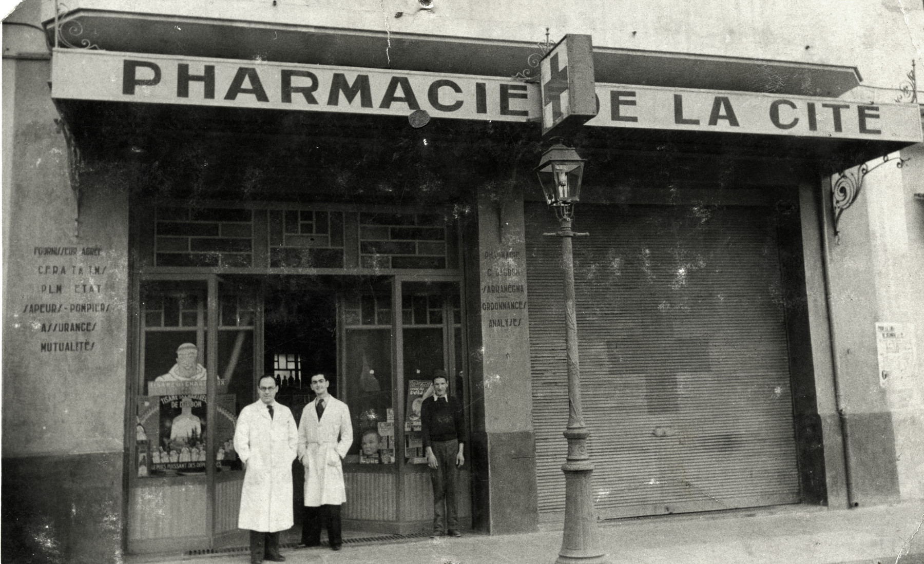 Josef Roger Cheraki stands in front of his pharmacy in Algiers.