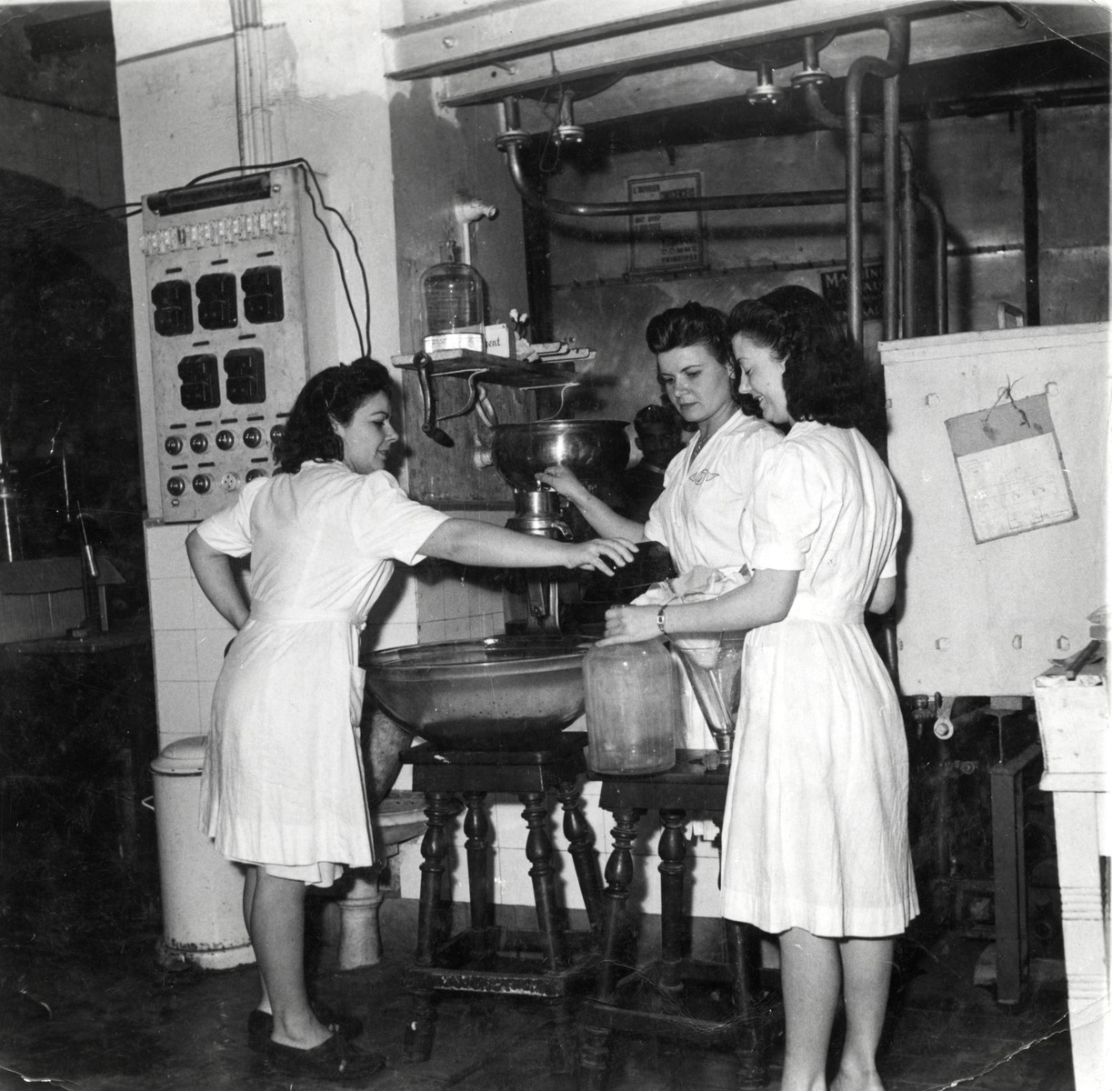 Female phamacists prepare medicine in Josef Cheraki's pharmacy in Algiers.