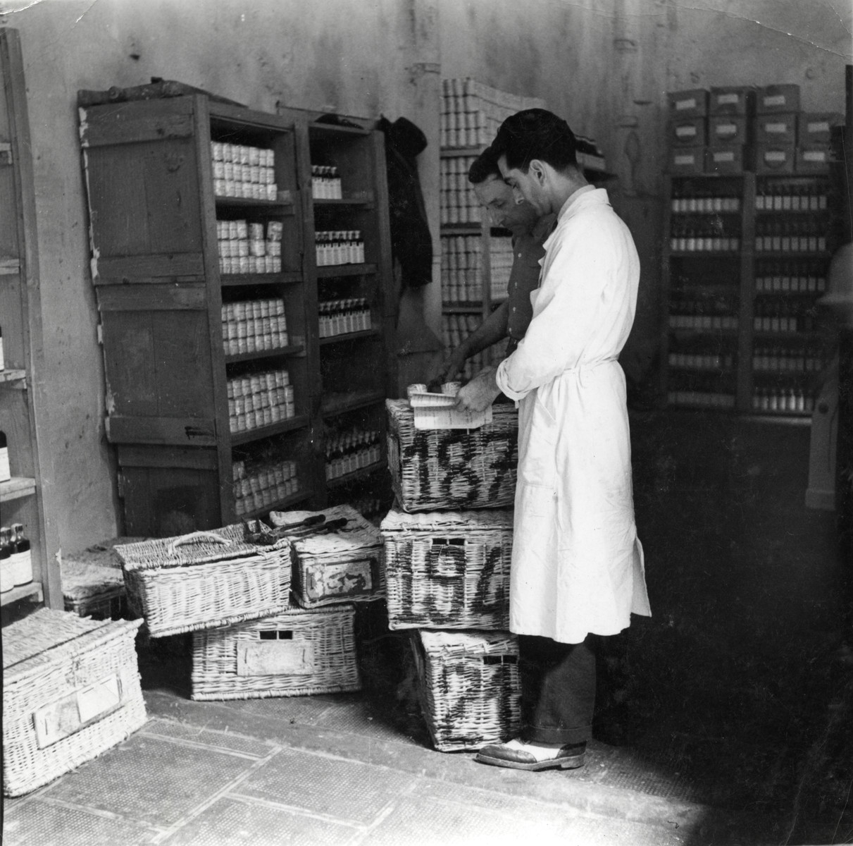 Josef Roger Cheraki works in a pharmacy in Algiers.