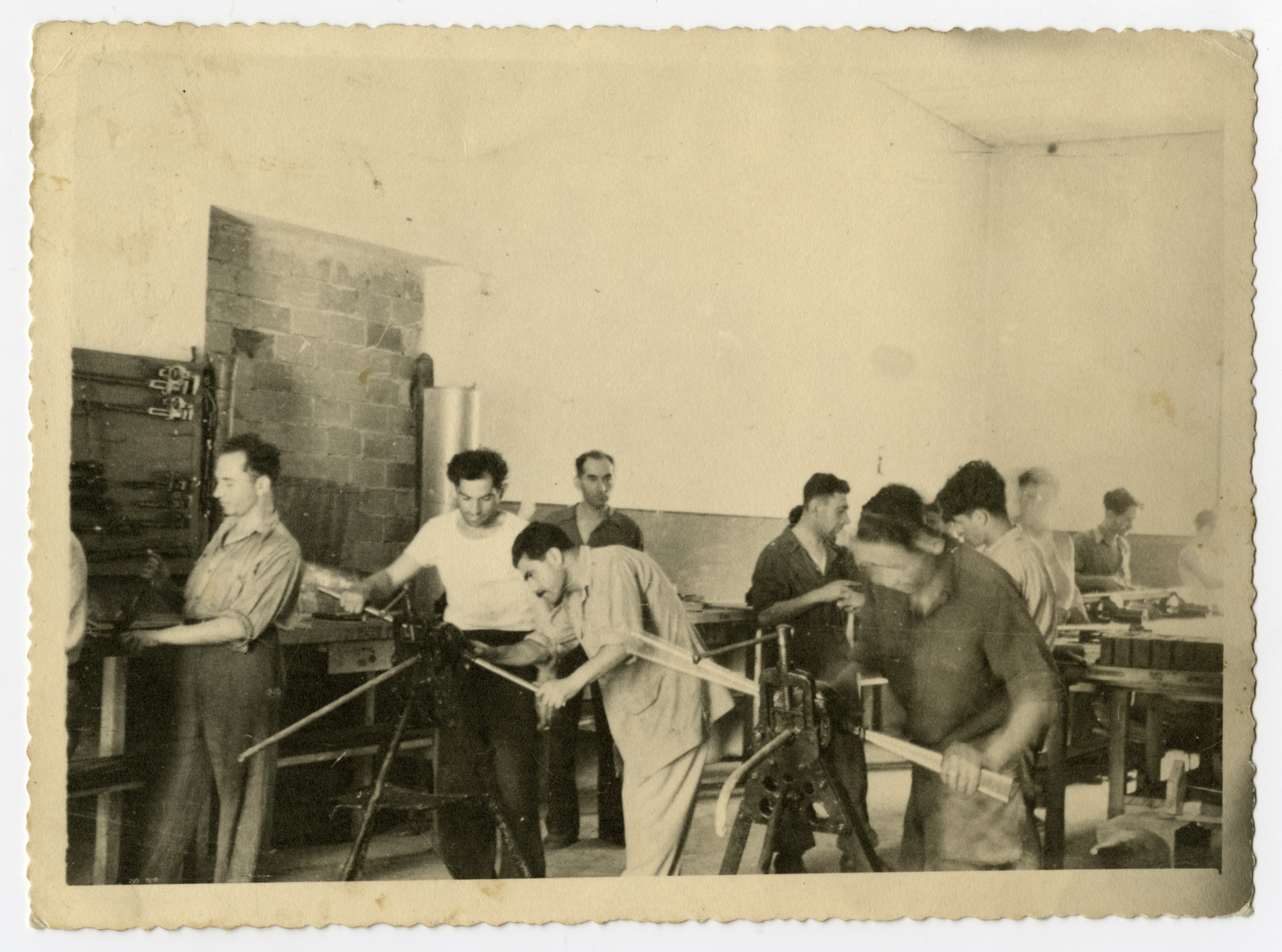 David Levi teaches plumbing to Jewish survivors in the Bagnoli displaced persons camp.