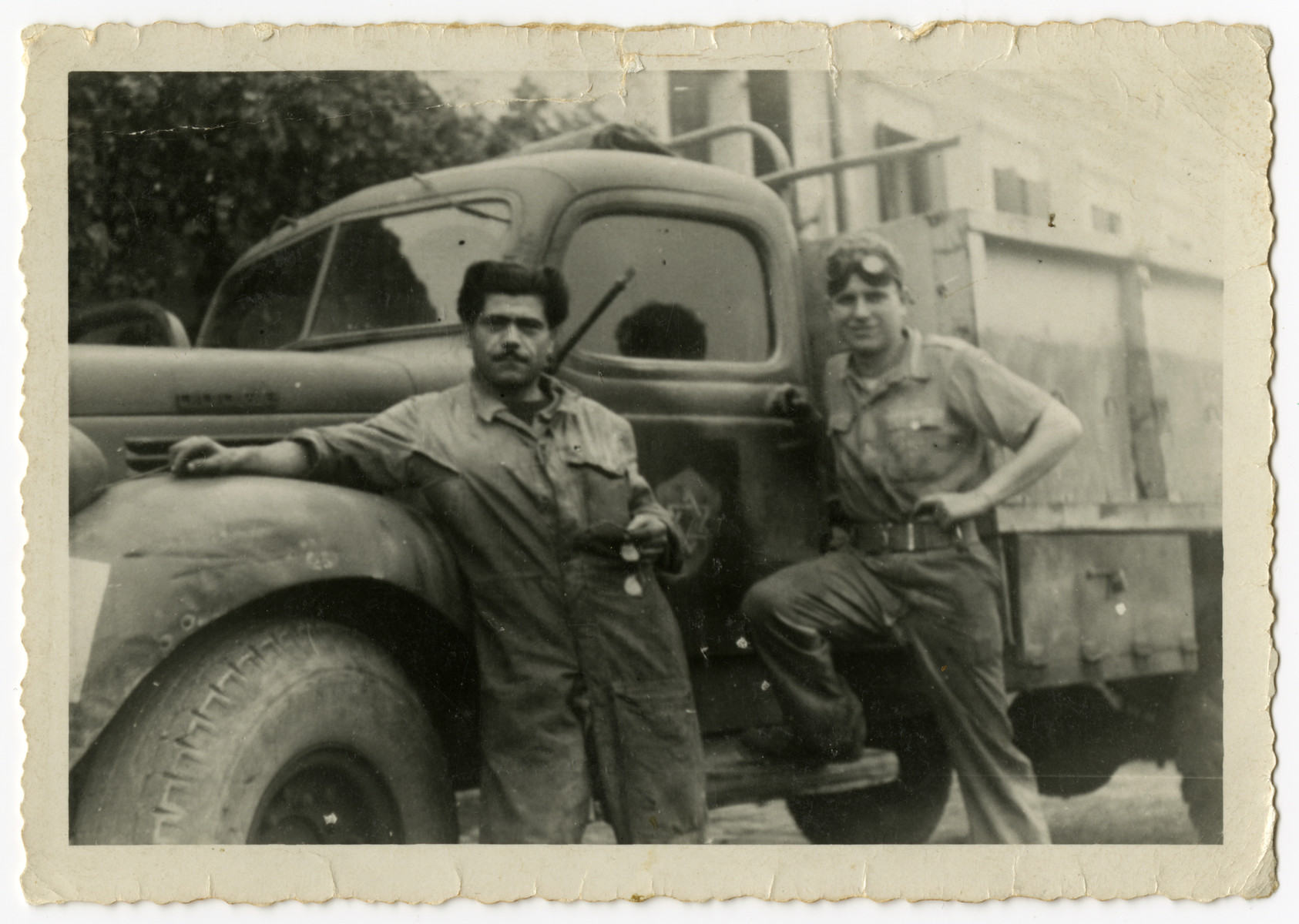 David Levi leans against the side of a truck while serving in the Jewish Brigade in Italy.