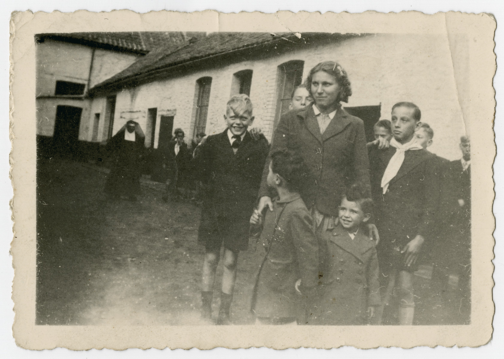 Two Jewish brothers stand in front of the Polish maid who is hiding them in the Belgian countryside.    Pictured are Nestor (right) and Jacques Hochglaube (left).