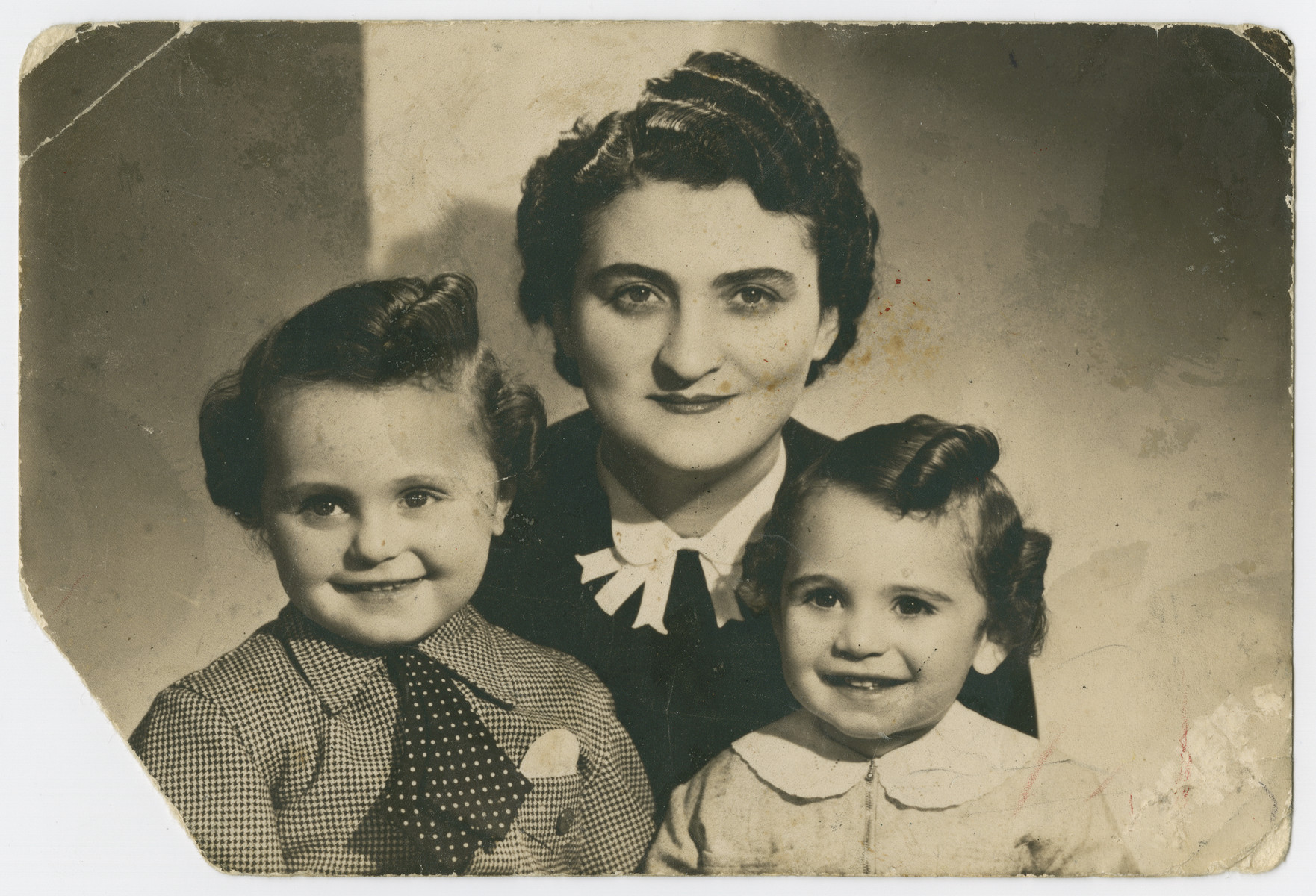 Studio portrait of Frymetta Hochglaube with her two children, Jacques (left) and Nestor (right), taken shortly before going into hiding.