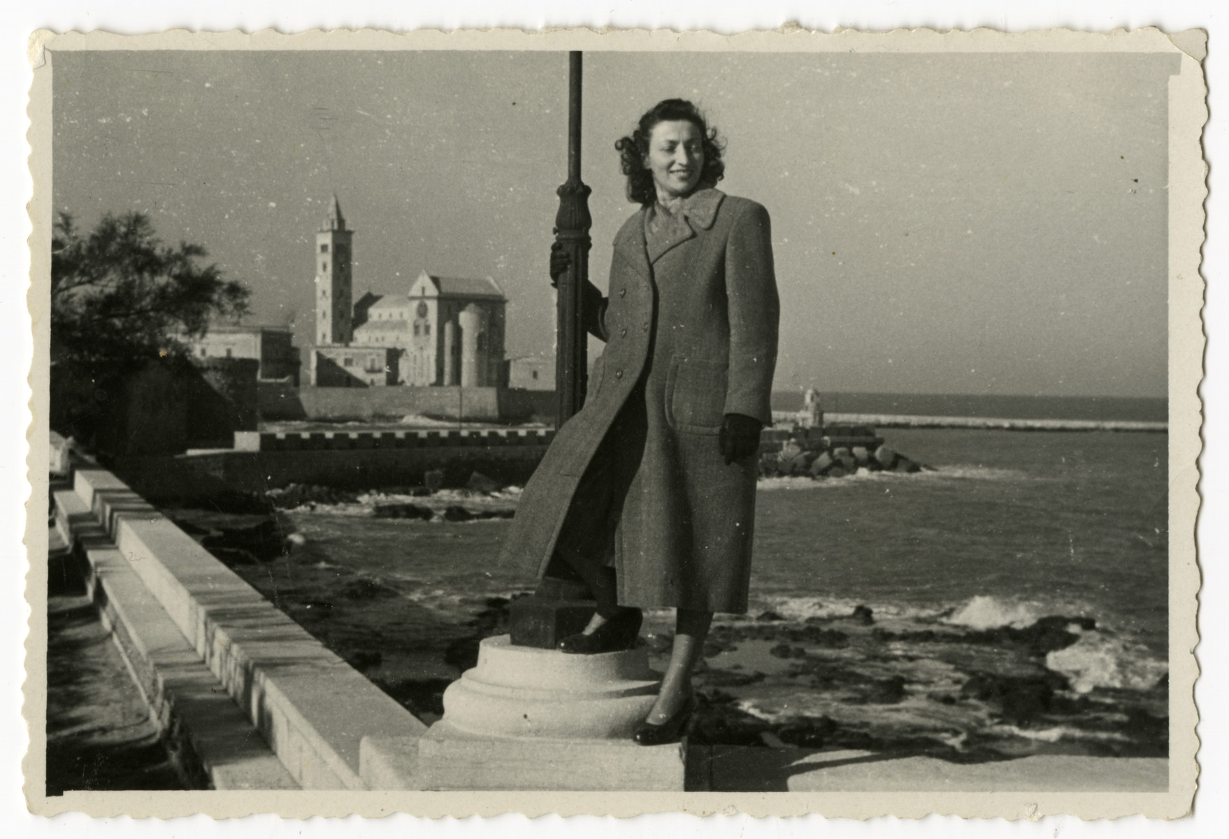 CLara Levy poses by the seashore shortly after her marriage.